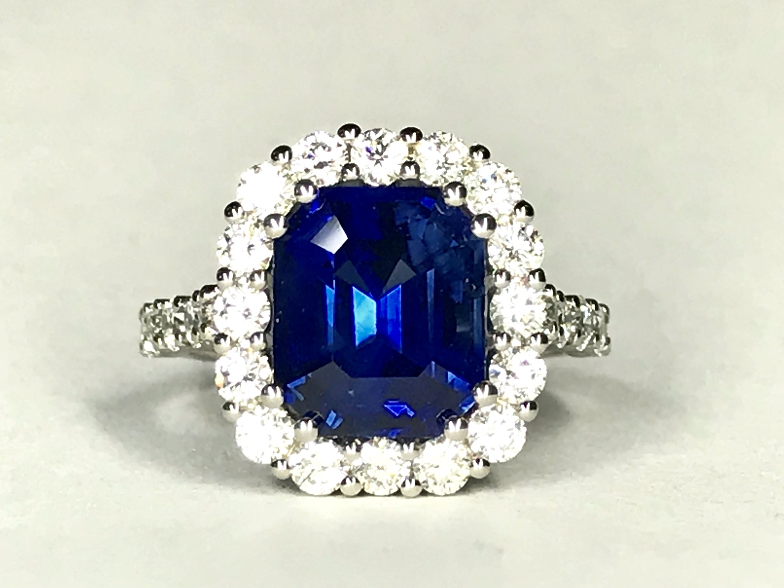 Copy of 5.03ct sapphire and diamond 1.03ct modern style claw set platinum cluster ring.  Made in Chichester, England.