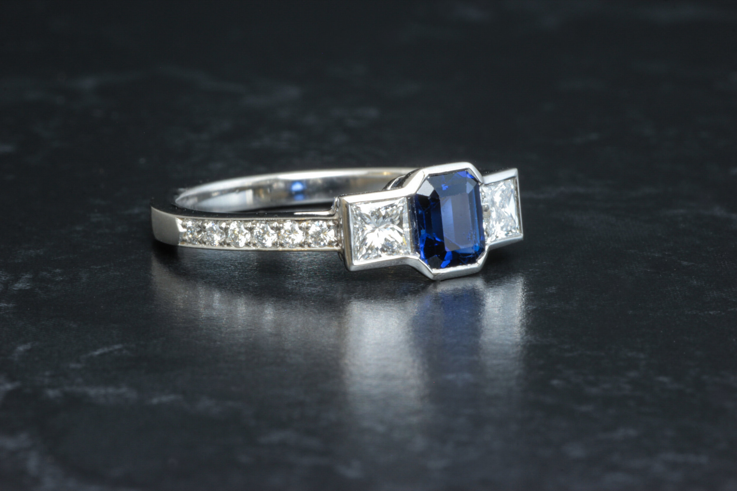 Copy of Octagonal 2.00ct sapphire and princess cut diamond 3 stone ring. made in Chichester, England.