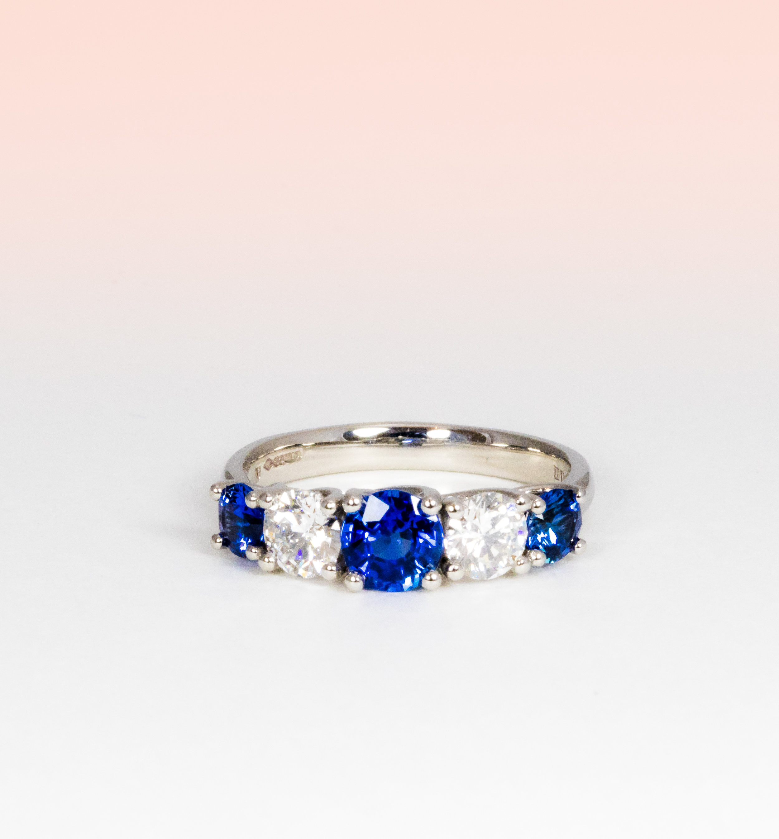 Platinum mounted, five stone sapphire and diamond ring. Made in Chichester, England.