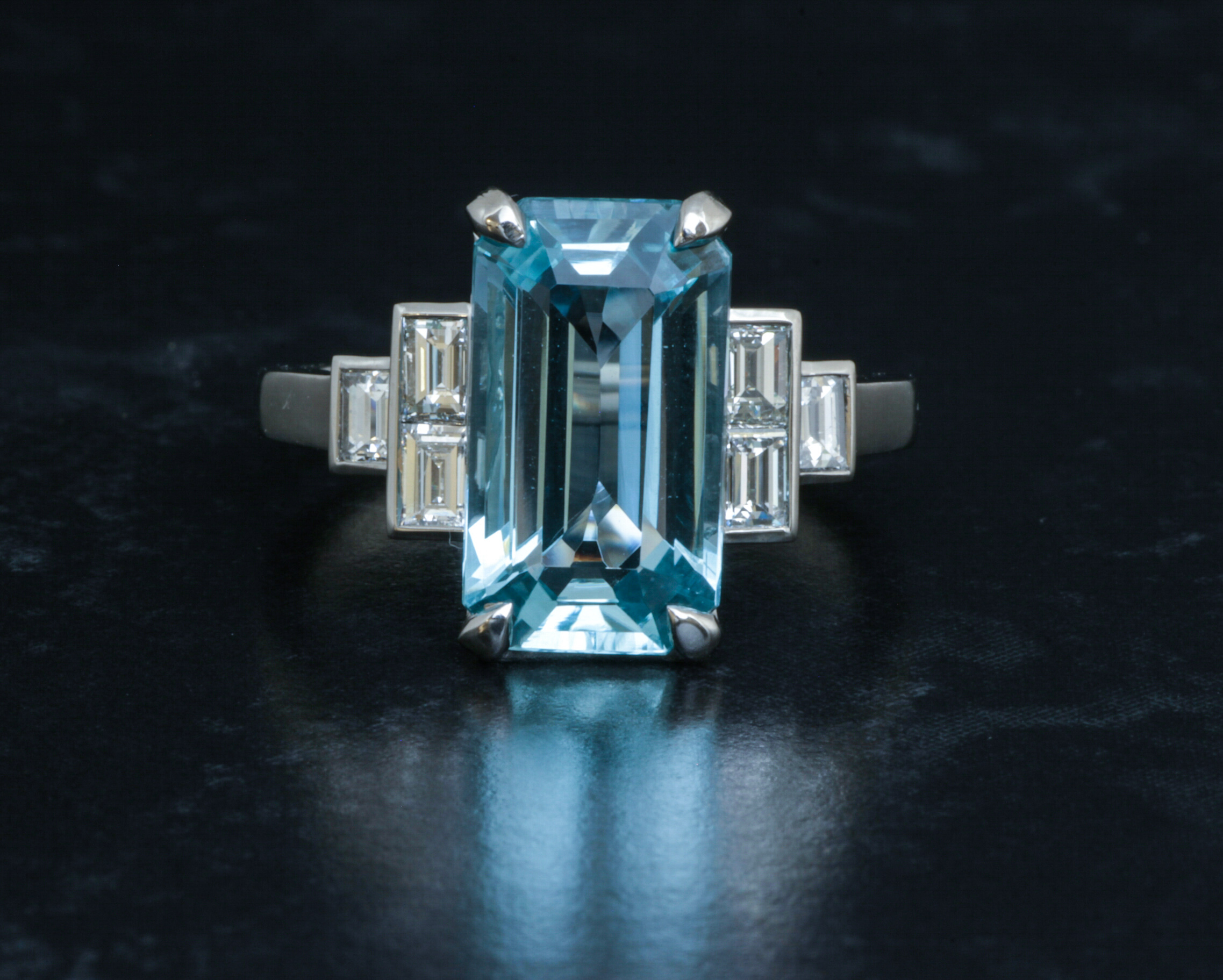 Aquamarine and stepped baguette diamond shoulder ring. Made in Chichester, England.