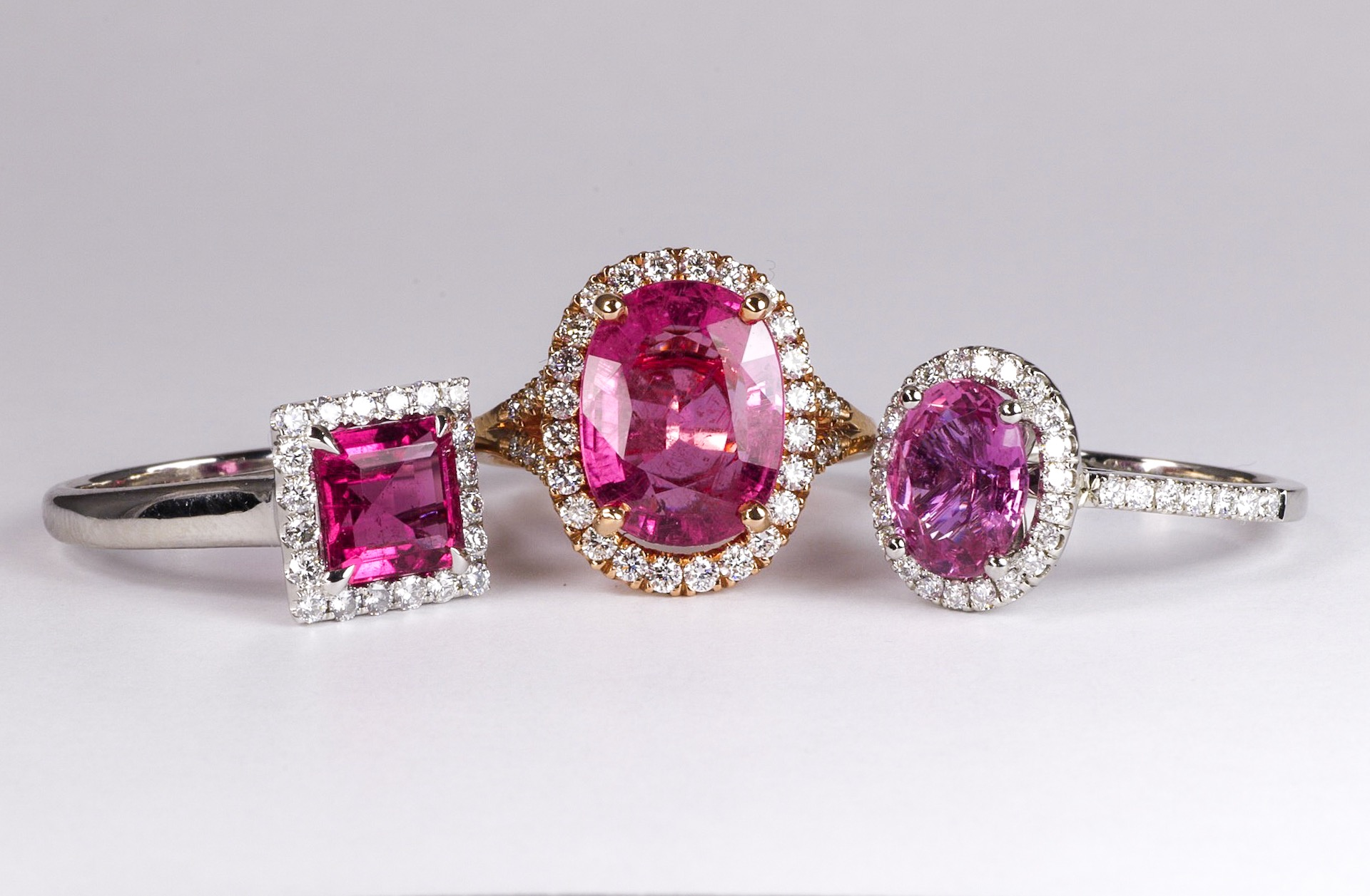 Middle and left - pink tourmaline and diamond. Right - pink sapphire and diamond.