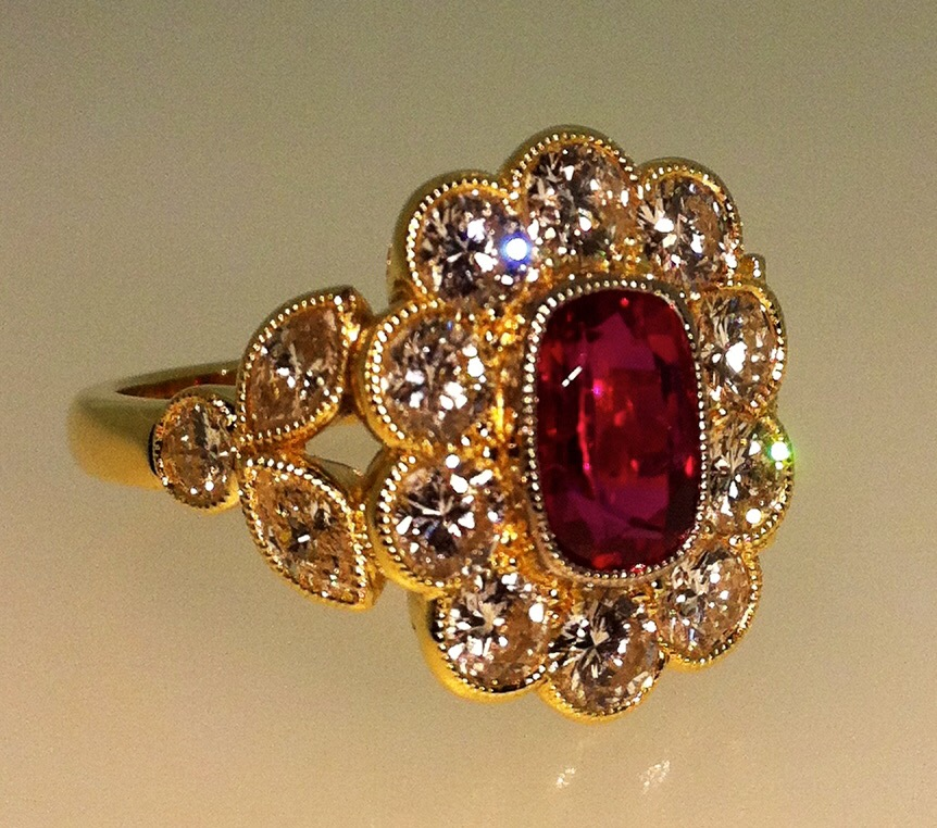 """18ct yellow gold ruby and diamond millegrain edge cluster ring with marquise diamond """"leaf"""" shoulders."""