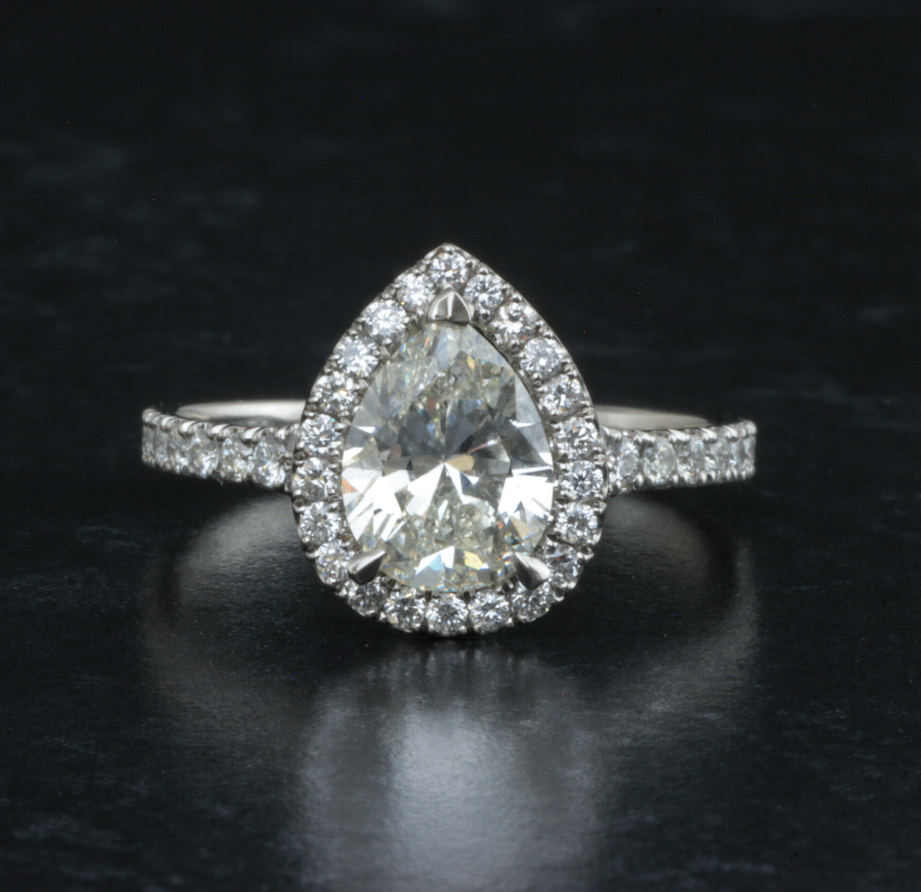 Platinum mounted pear shaped diamond halo cluster. Made in Chichester, England.