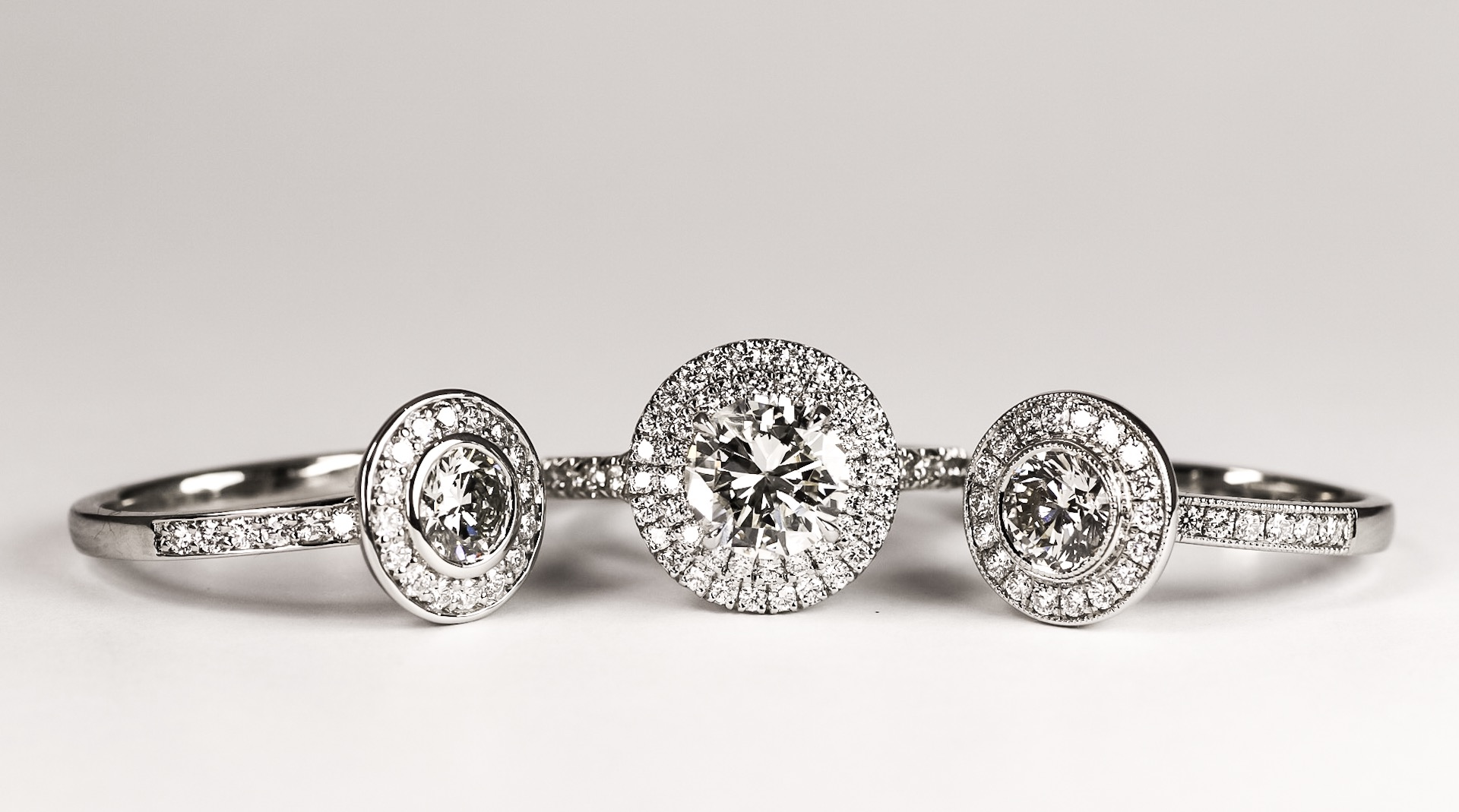 Copy of Three pretty round diamond cluster rings. Made in Chichester, England.