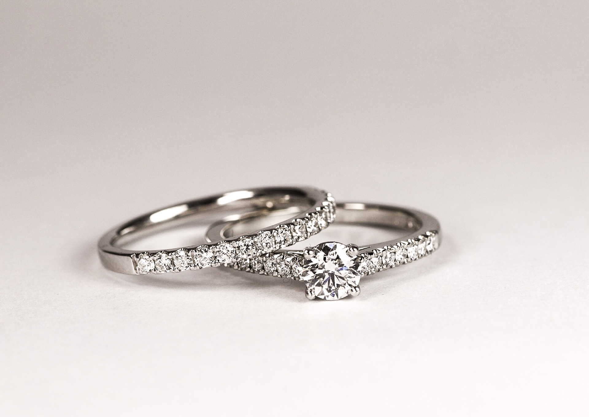 Copy of Four claw set 0.37ct diamond solitaire with cut away set shoulders and matching band. Made in Chichester, England.