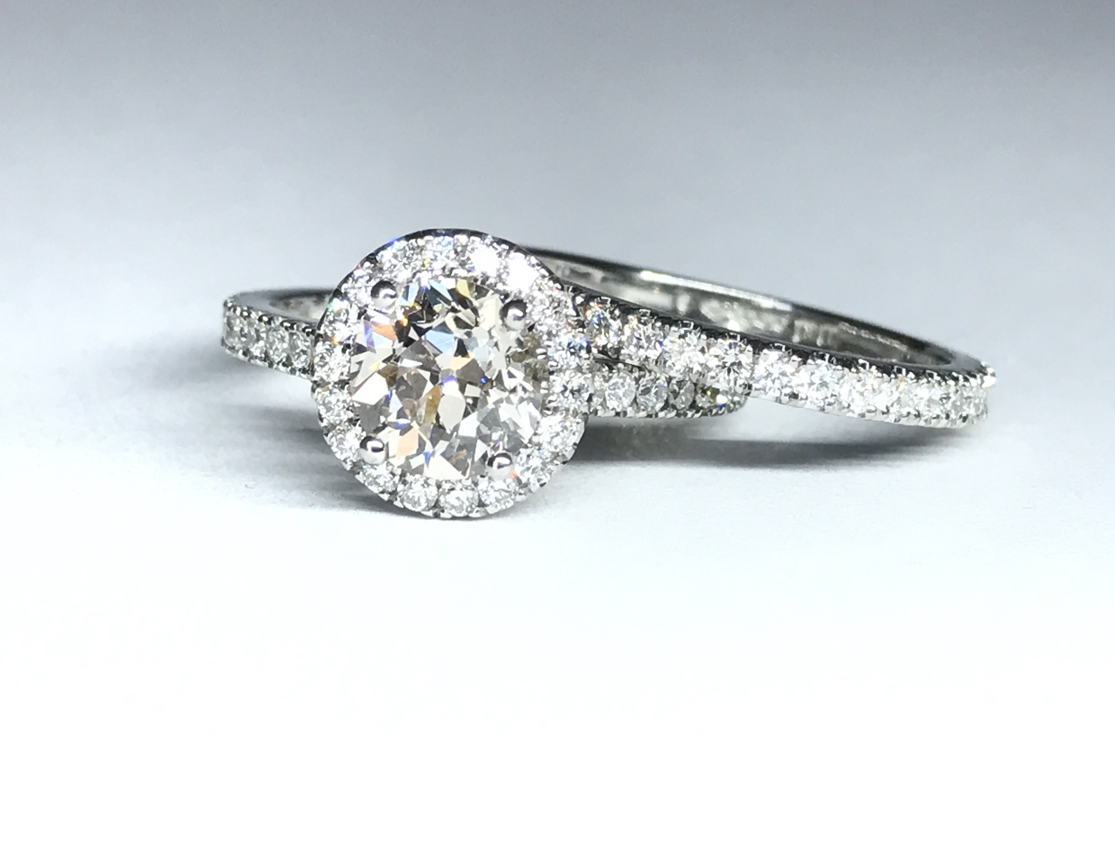 Copy of Round halo diamond cluster ring with matching eternity ring. Made in Chichester, England.