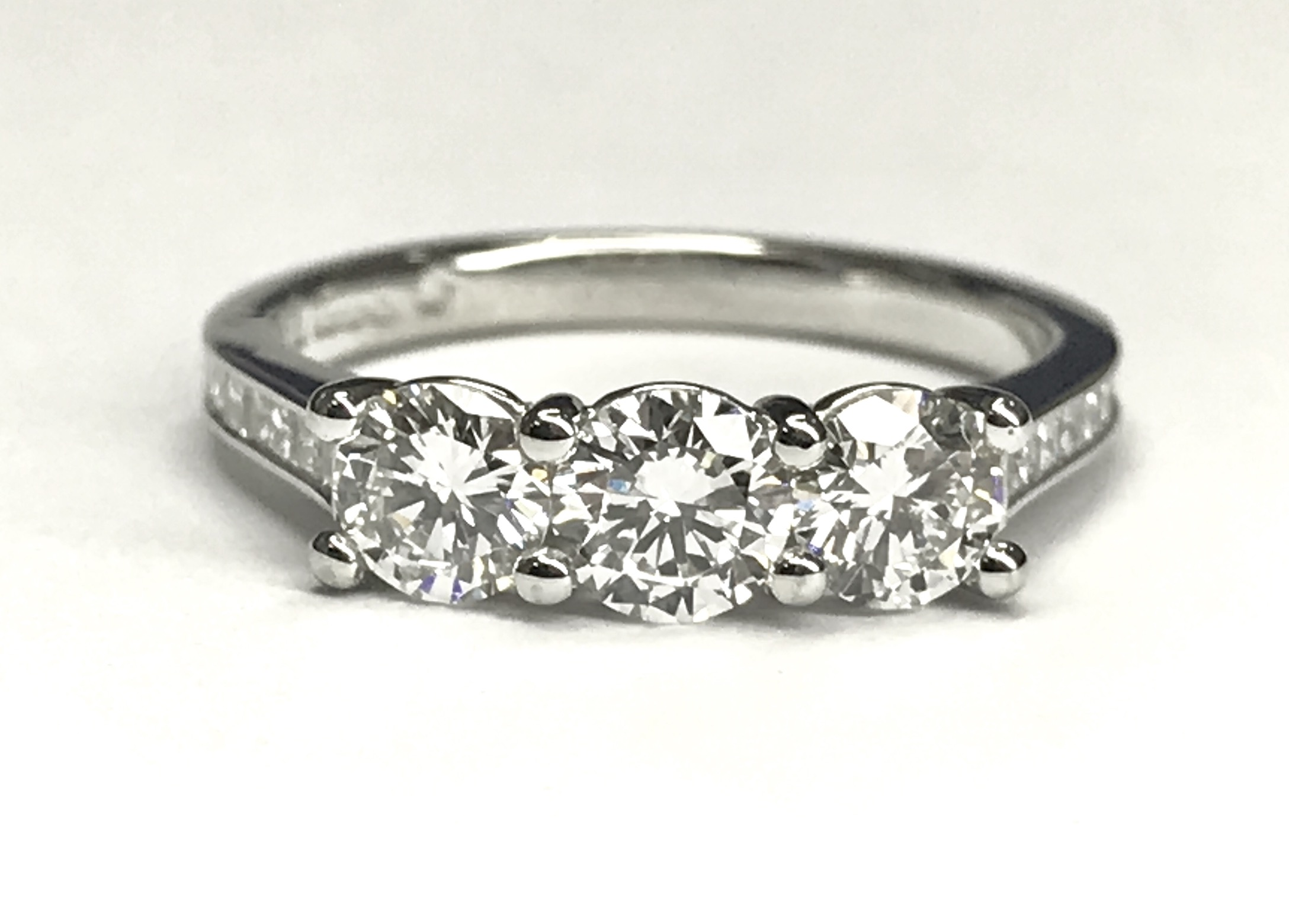Copy of  Modern 3 stone diamond ring with channel set diamond shoulders. Made in Chichester, England.