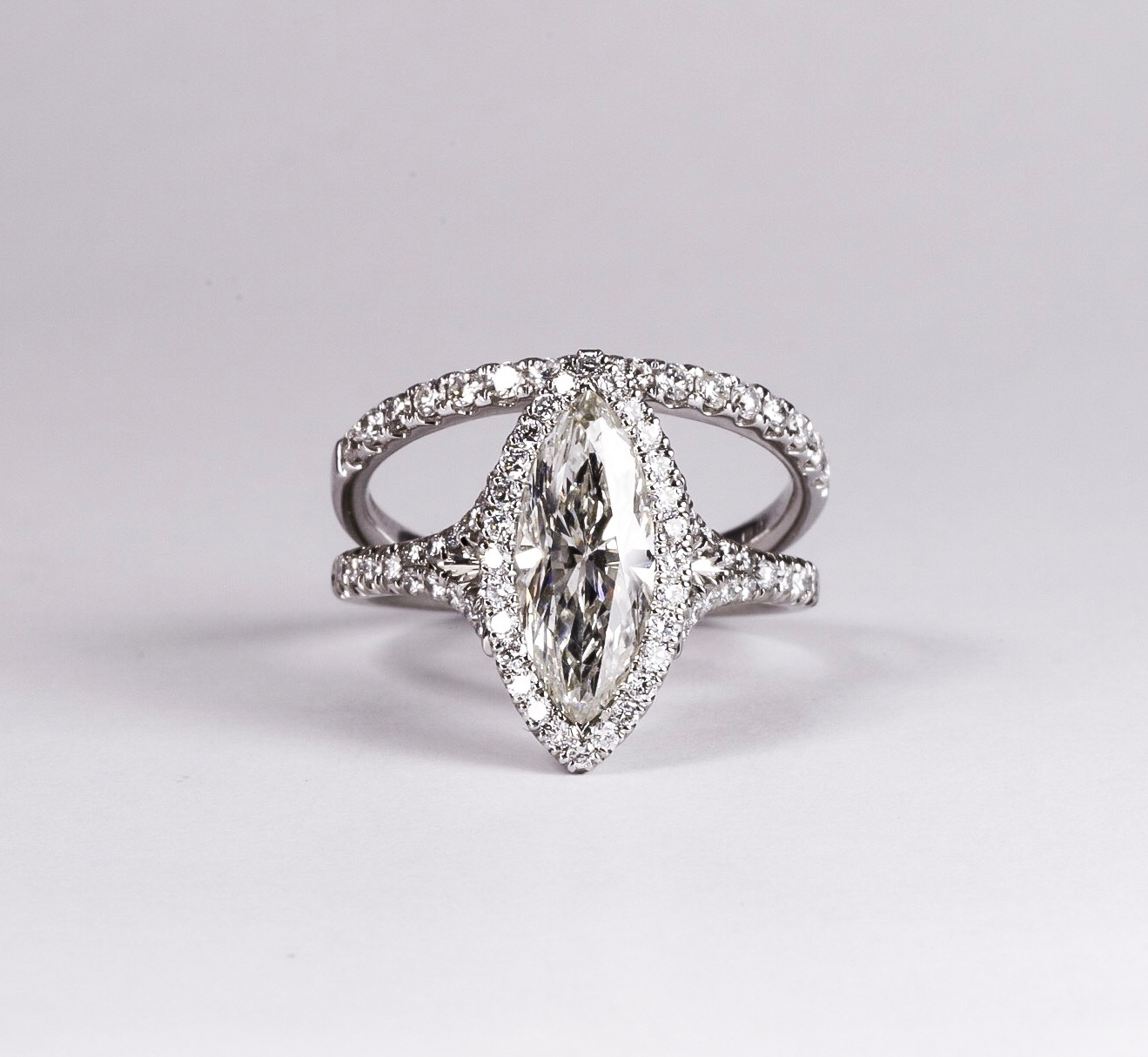 Copy of Stunning marquise diamond set halo cluster ring with diamond set split shoulders. Made in Chichester, England.