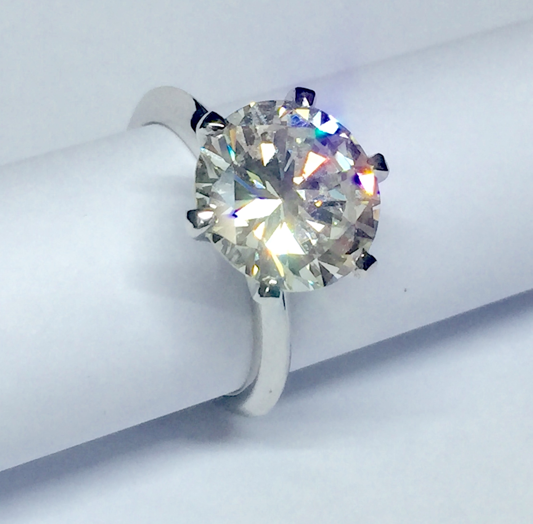 Copy of 4ct brilliant cut diamond solitaire ring. Made in Chichester, England.