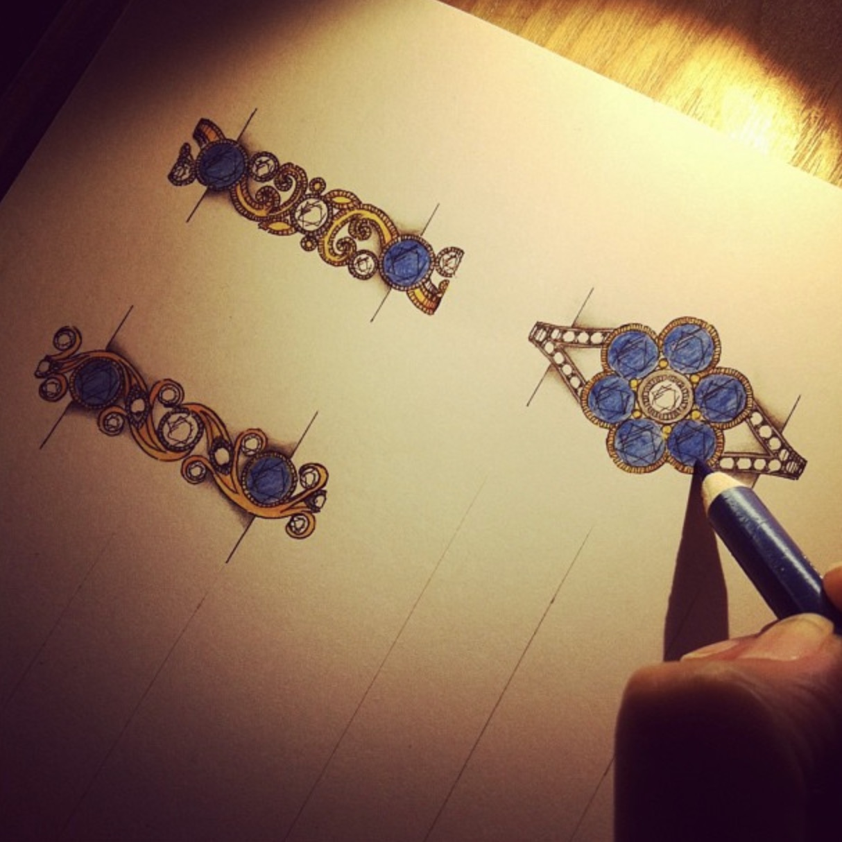 Foliate sapphire and diamond bands and a cluster. Choices for a customer with stones from two old rings.