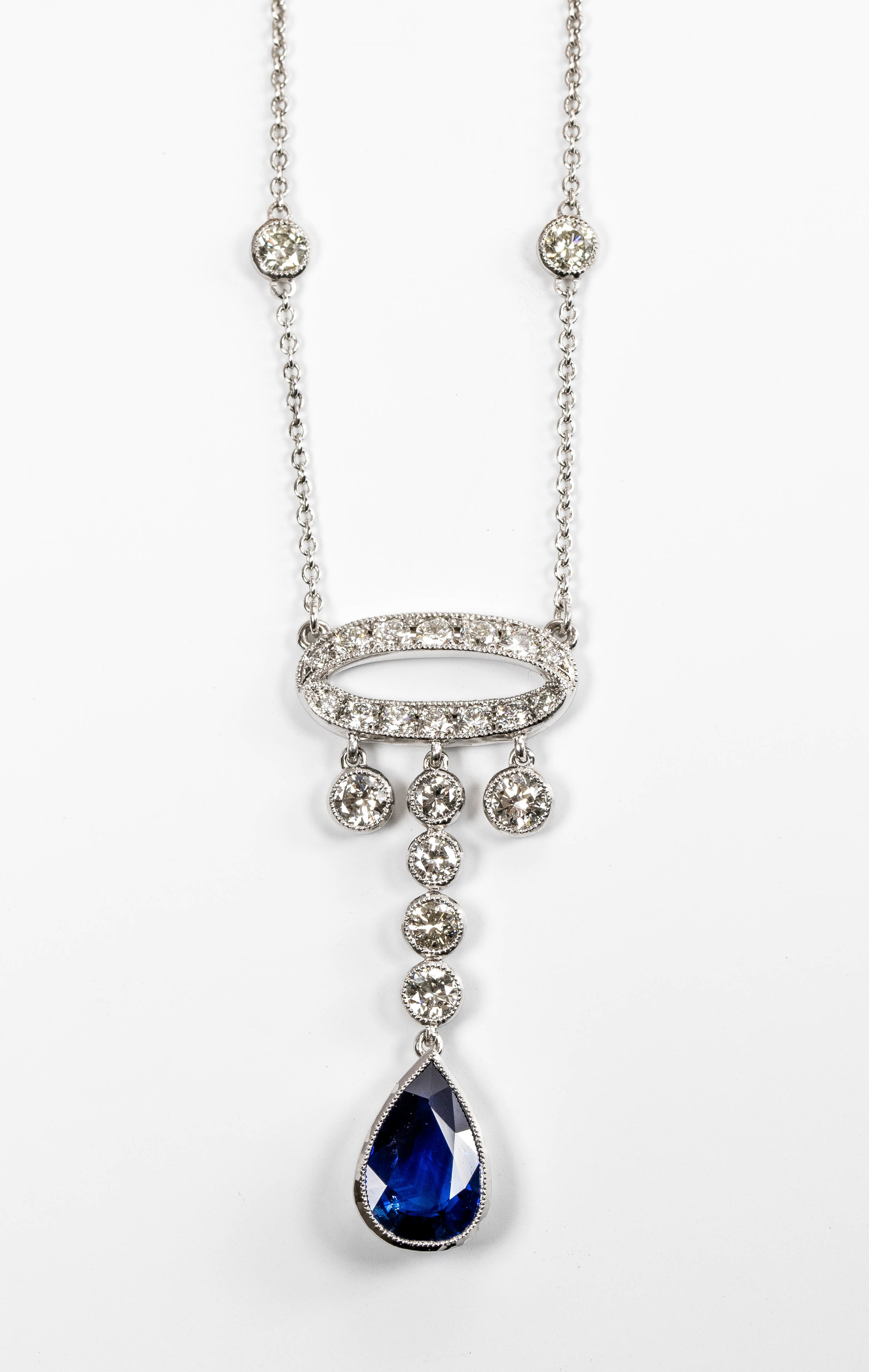 3.04ct pear shaped sapphire and diamond set (our customers stones). Made in Chichester, England.