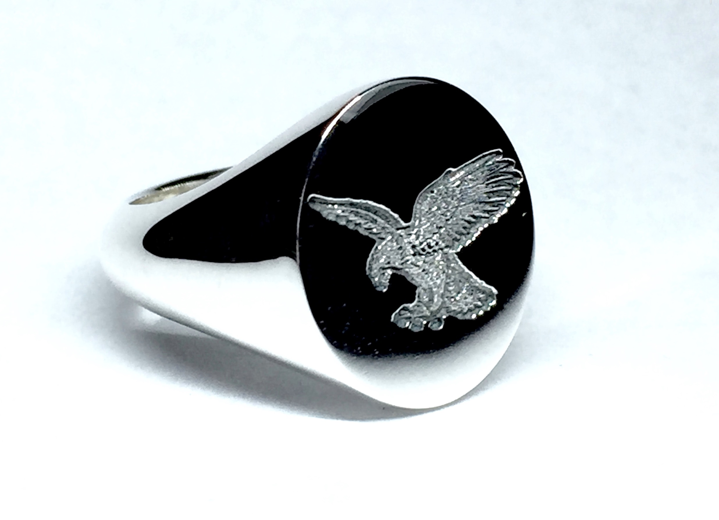 This ring was cast with the eagle added by our cad designers, no hand carving required on this one!