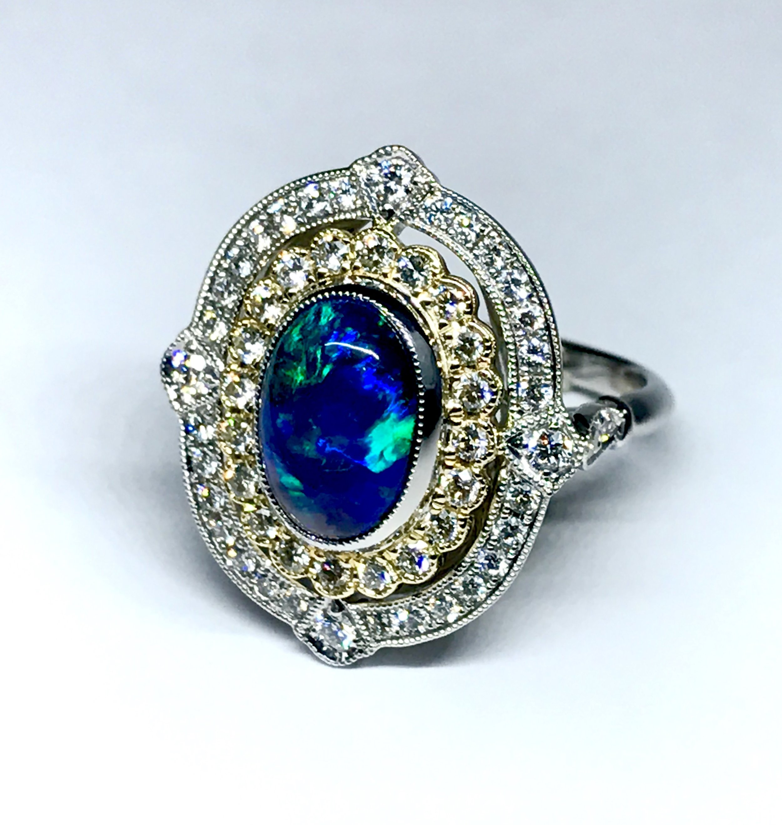 Black opal and diamond Edwardian style oval cluster ring. Made in Chichester, England.
