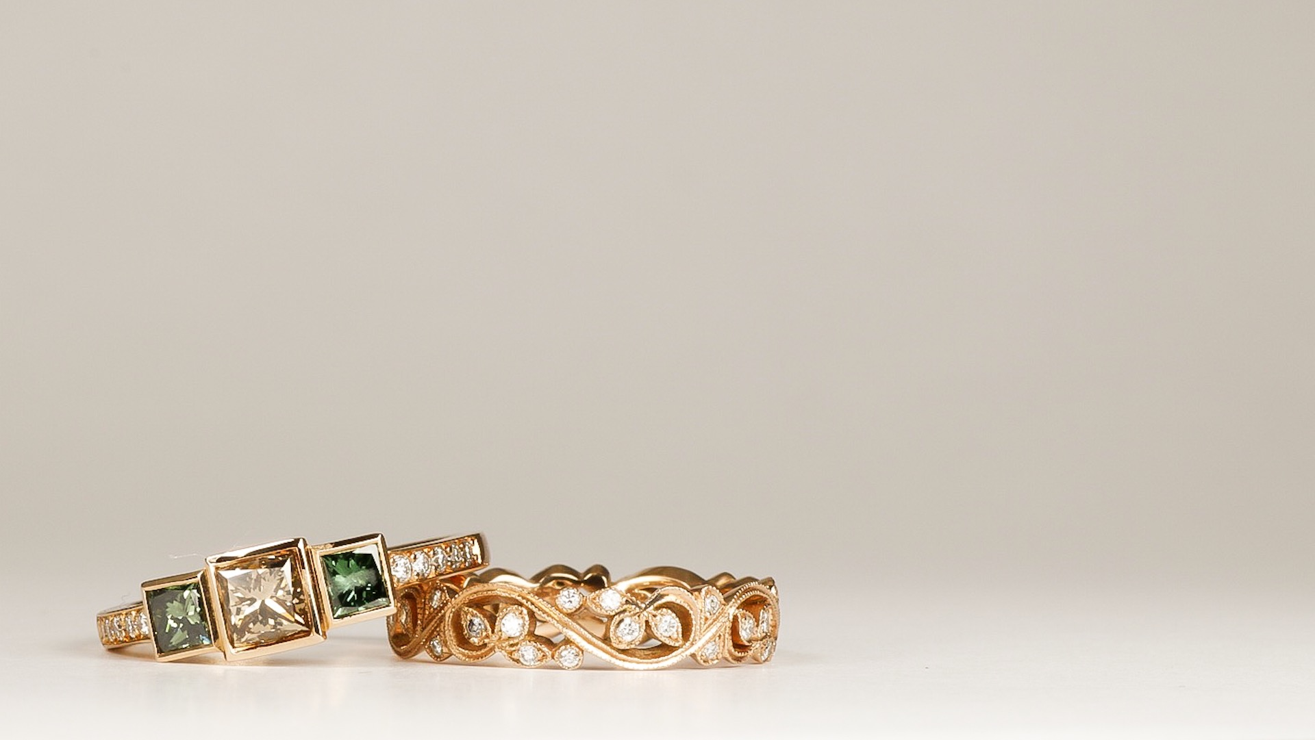 White, brown and treated green diamond 3 stone ring with foliate diamond set band. Made in Chichester, England.