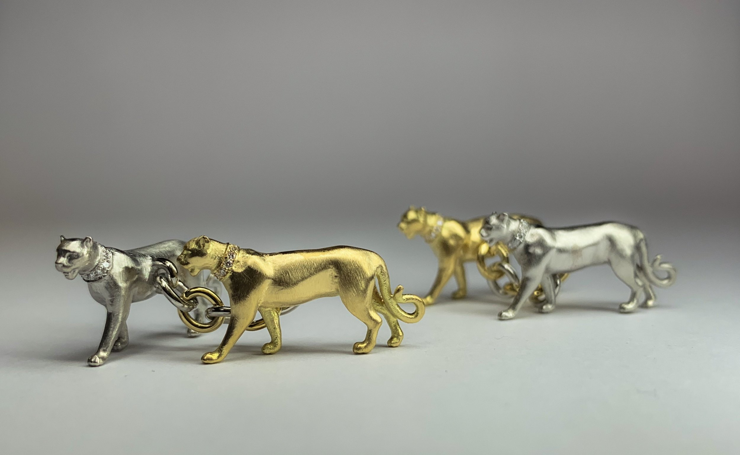 18ct yellow gold and platinum panther cufflinks. Each collar is set with ten 0.7mm diamonds and each diamond has 57 facets! Incredible precision on something so small. Made in Chichester, England.