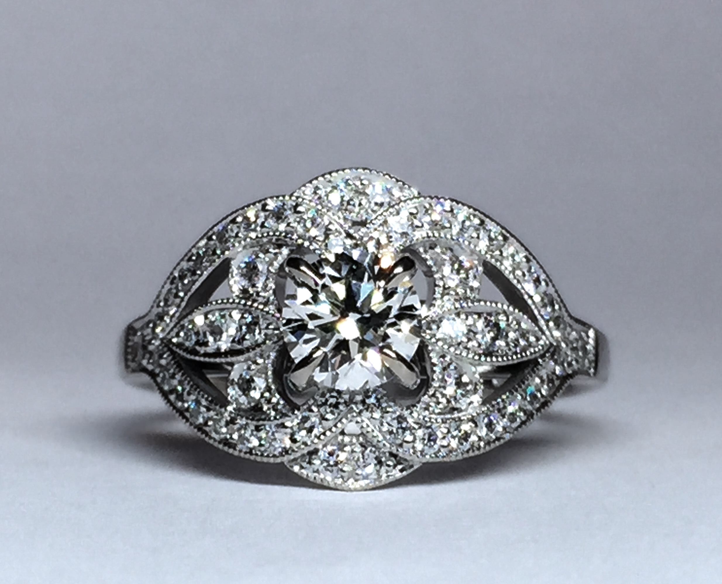 Copy of Pretty early C20th style diamond cluster ring made for customers centre stone. Made in Chichester, England.