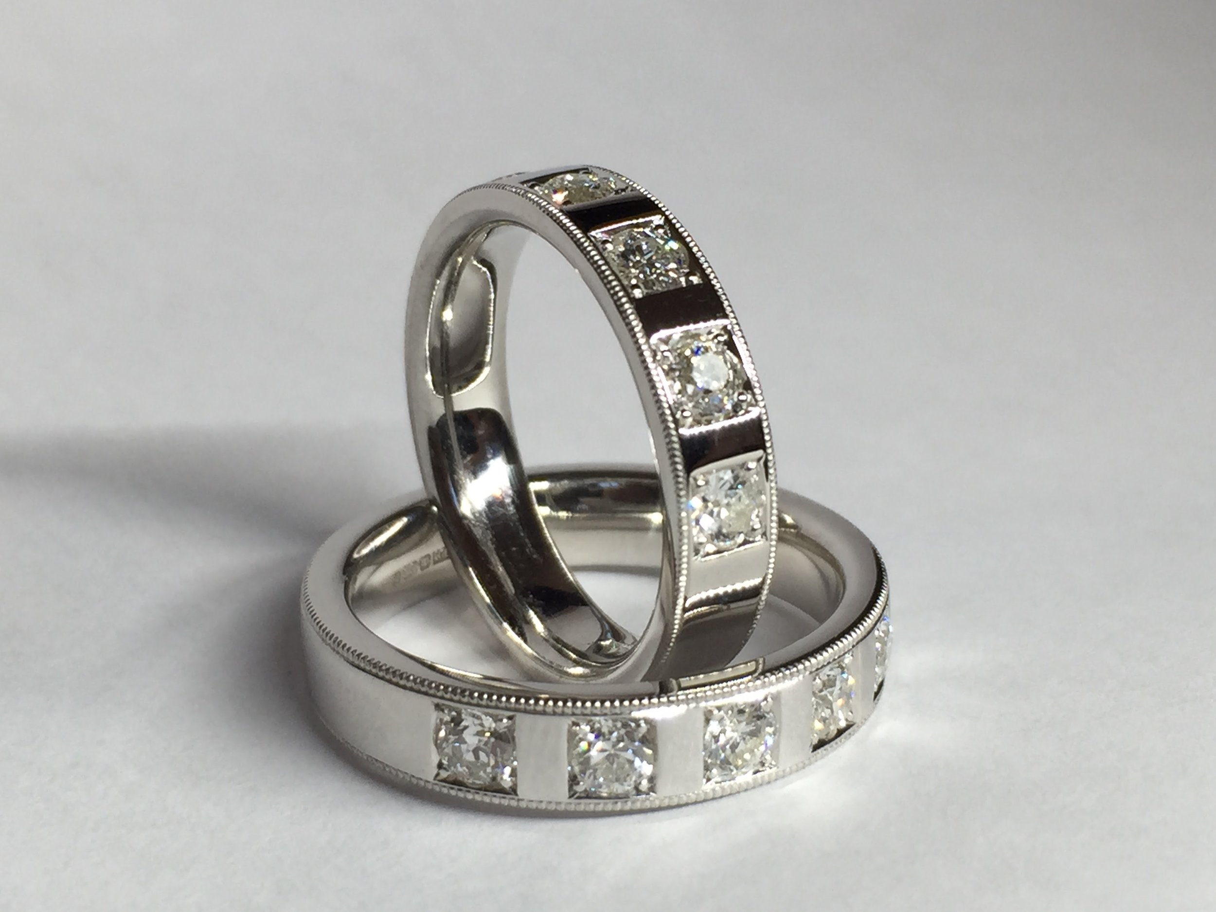 Copy of Matching set of wedding rings made with customers old cut diamonds. Grain set with millegrain edge decoration. Made in Chichester, England.