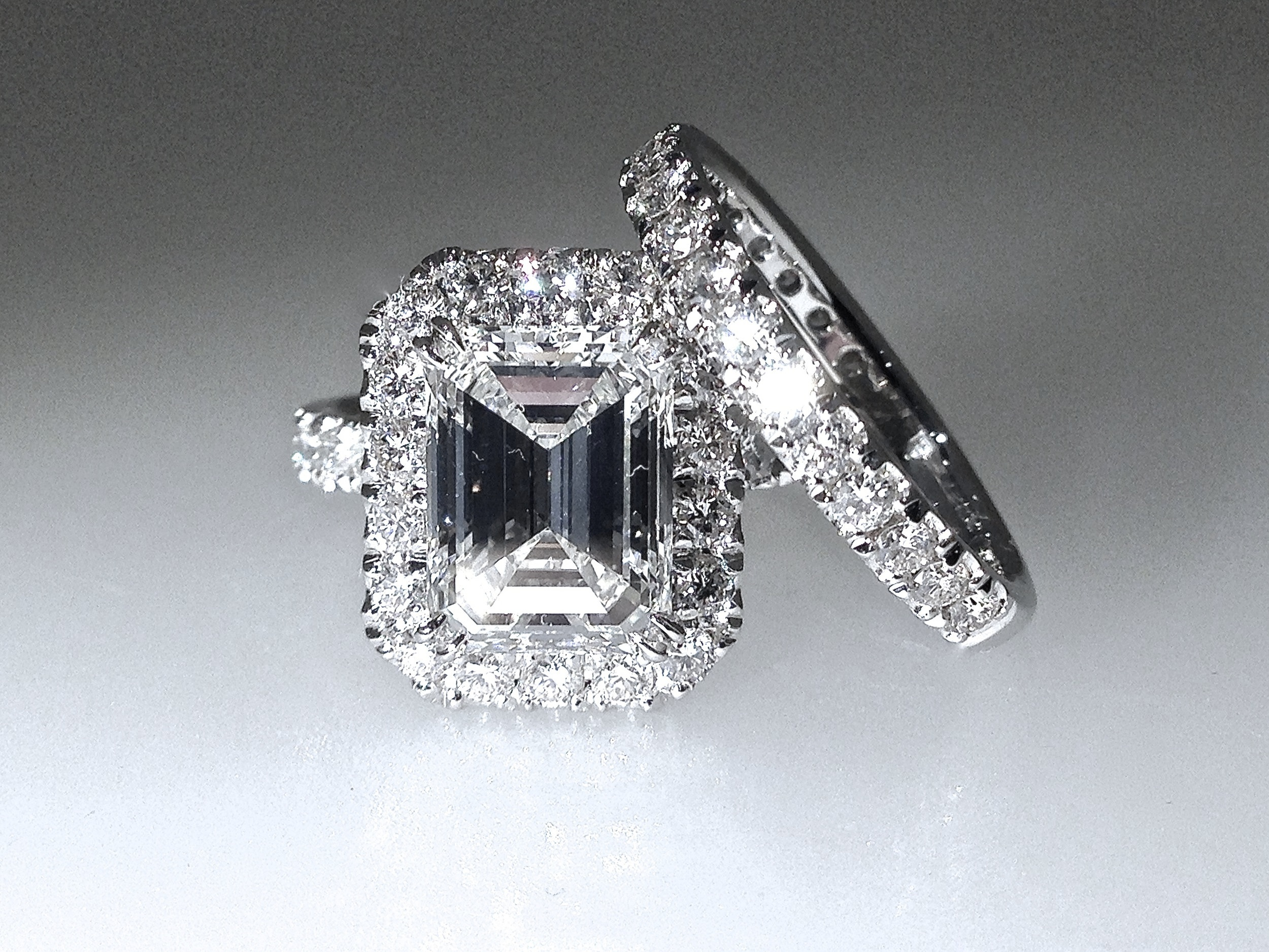 Copy of Matching emerald cut diamond cluster and diamond set band.  Made in Chichester, England.