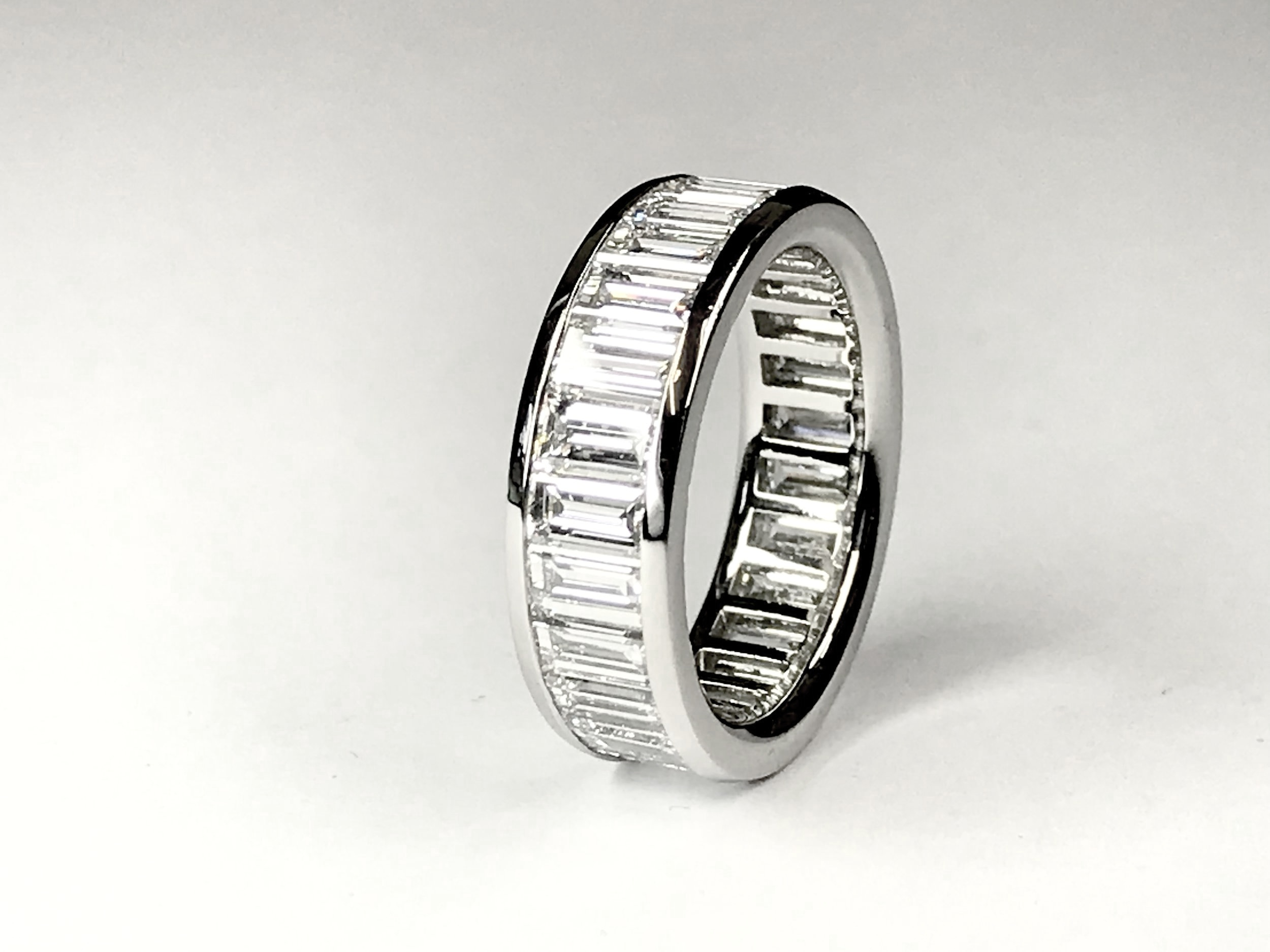 Copy of Platinum mounted 5ct total baguette cut diamond eternity ring. Made in Chichester, England.
