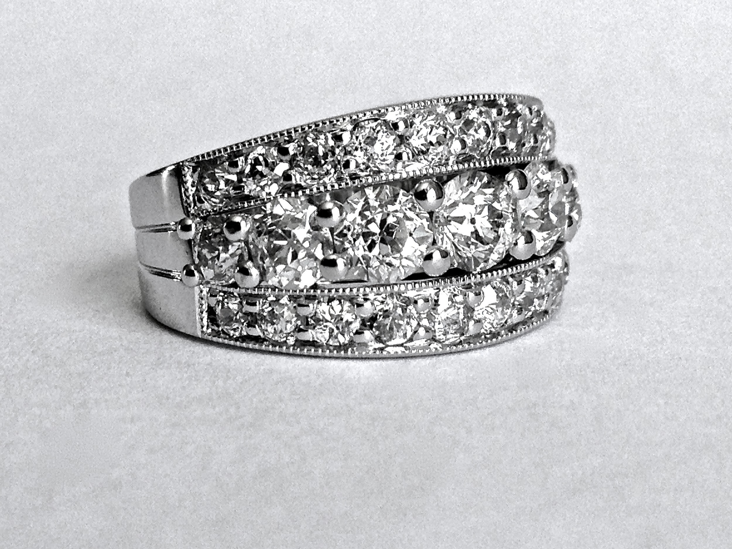 Copy of Platinum mounted 3 row diamond band. Made in Chichester, England.