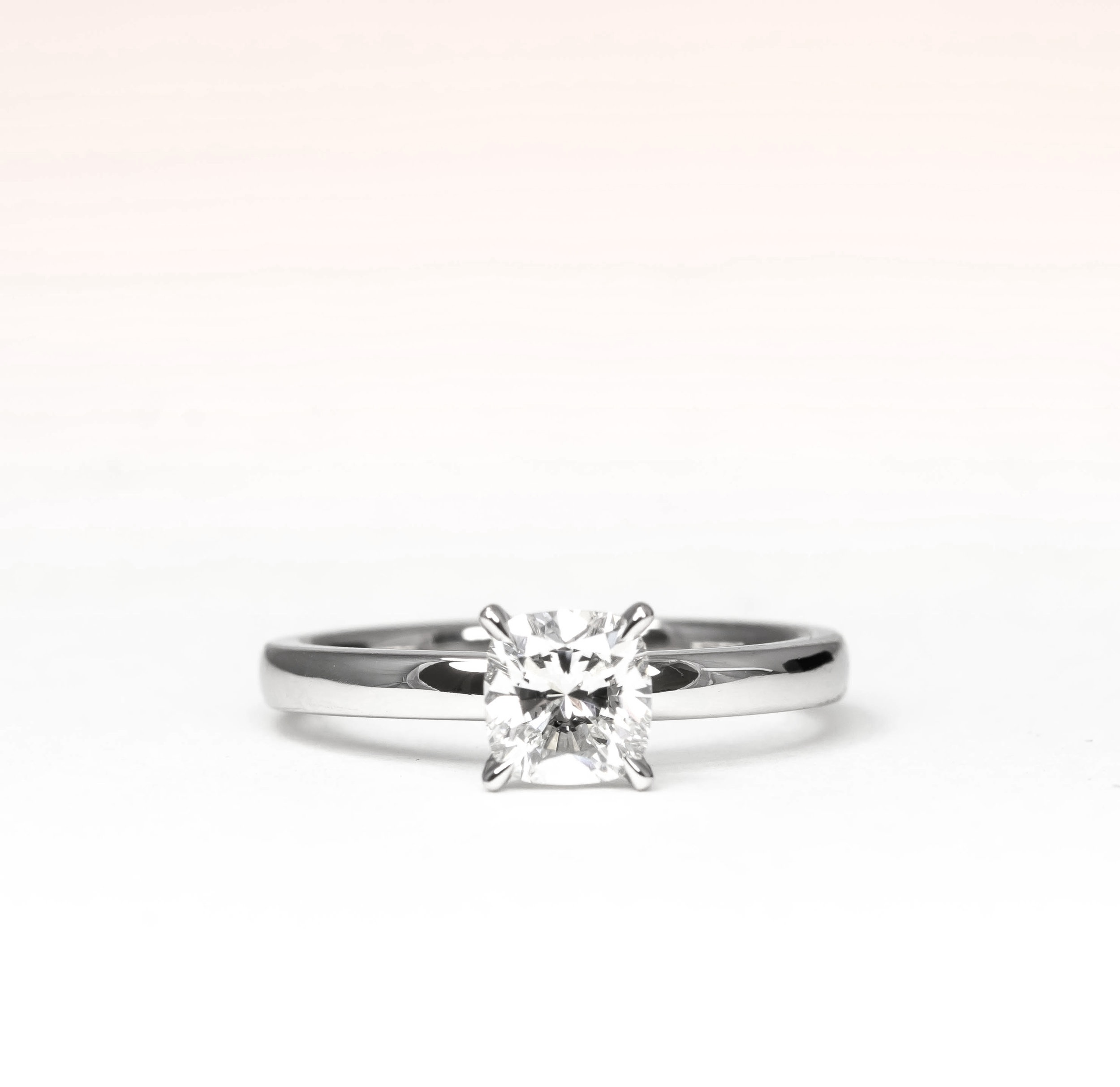Copy of Cushion brilliant cut diamond solitaire ring. Made in Chichester, England.