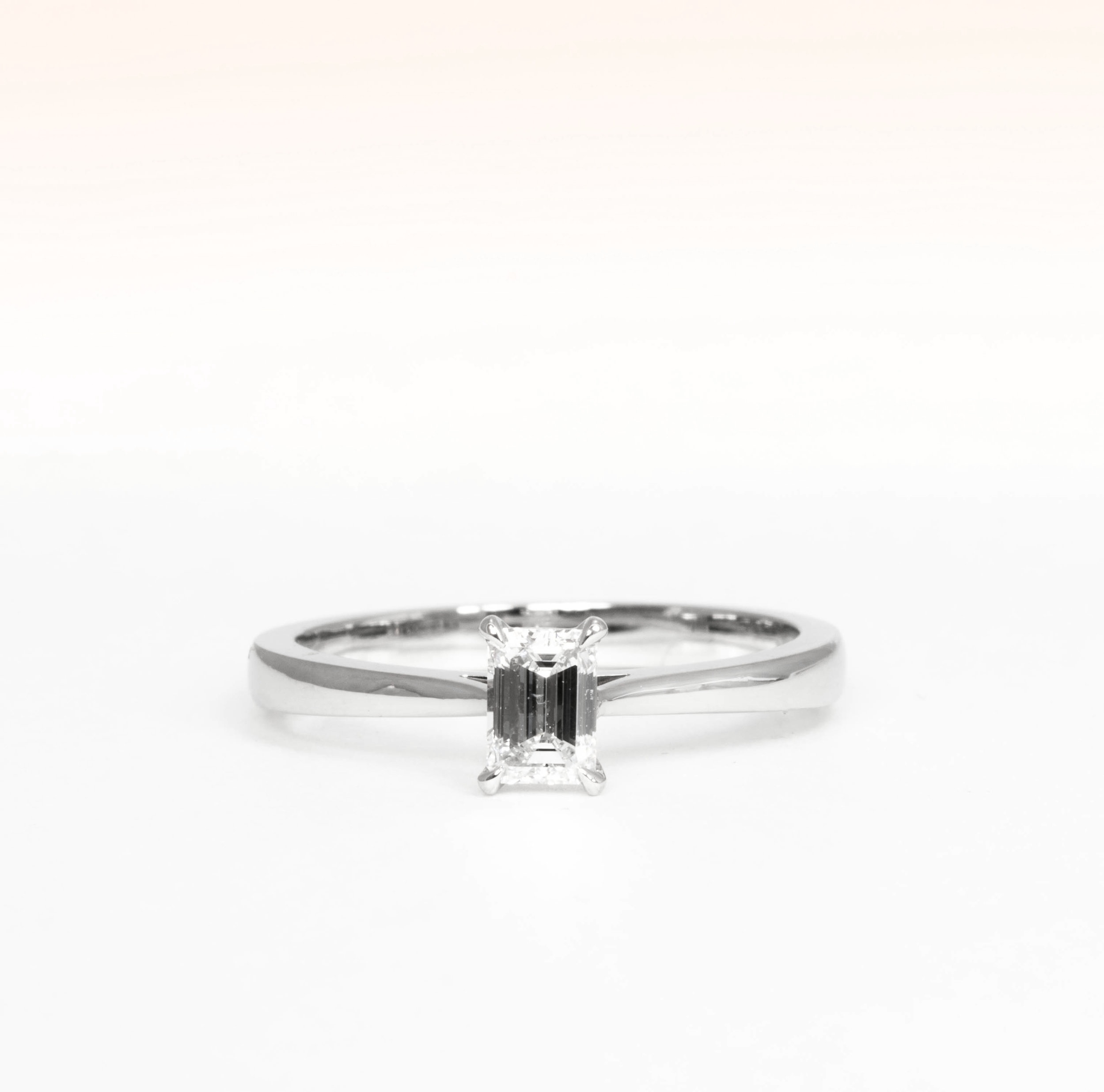 Copy of Platinum mounted classic emerald cut diamond solitaire. made in Chichester, England.