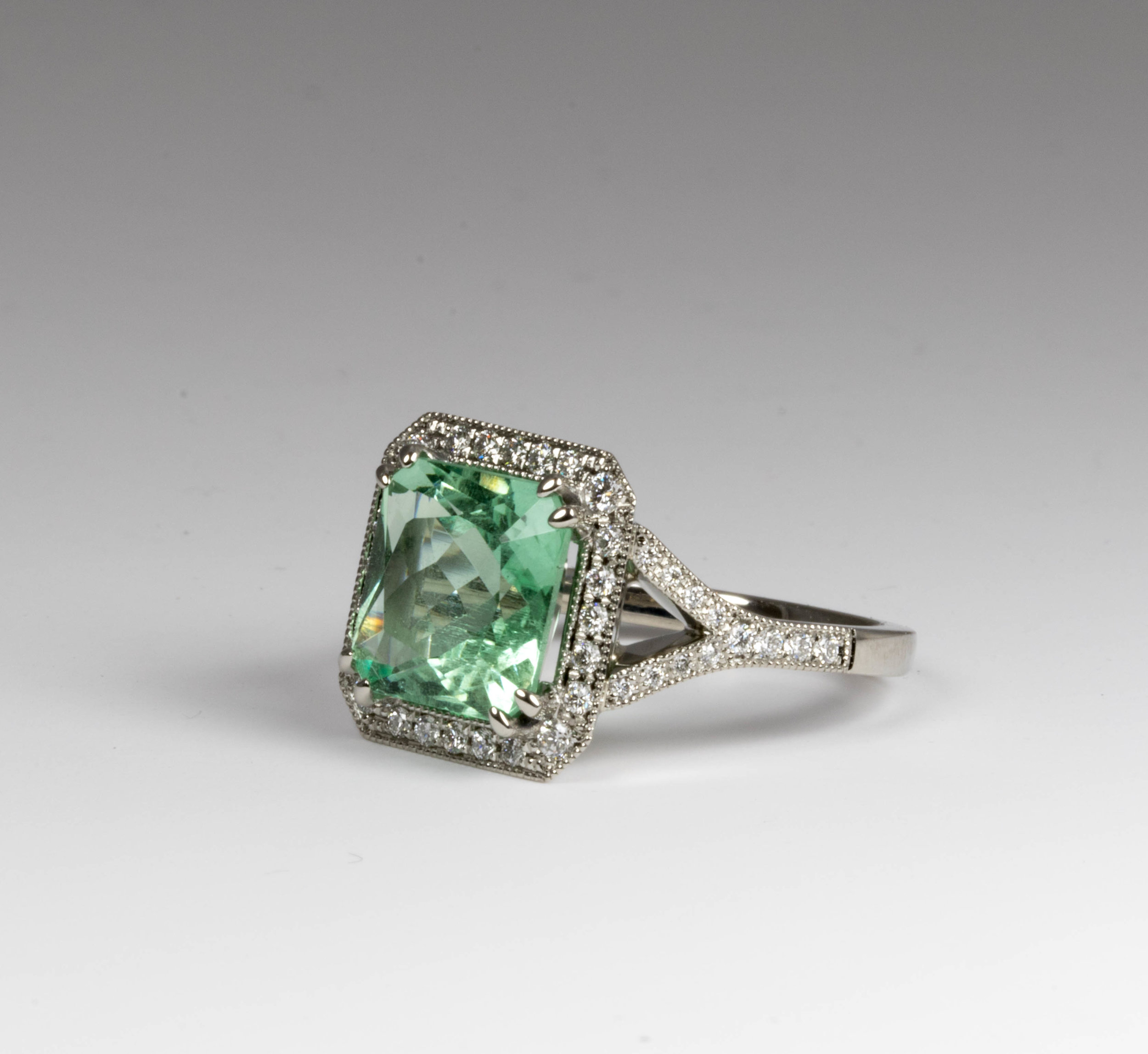 Green/blue aquamarine (Beryl) and diamond ring. Made in Chichester, England.