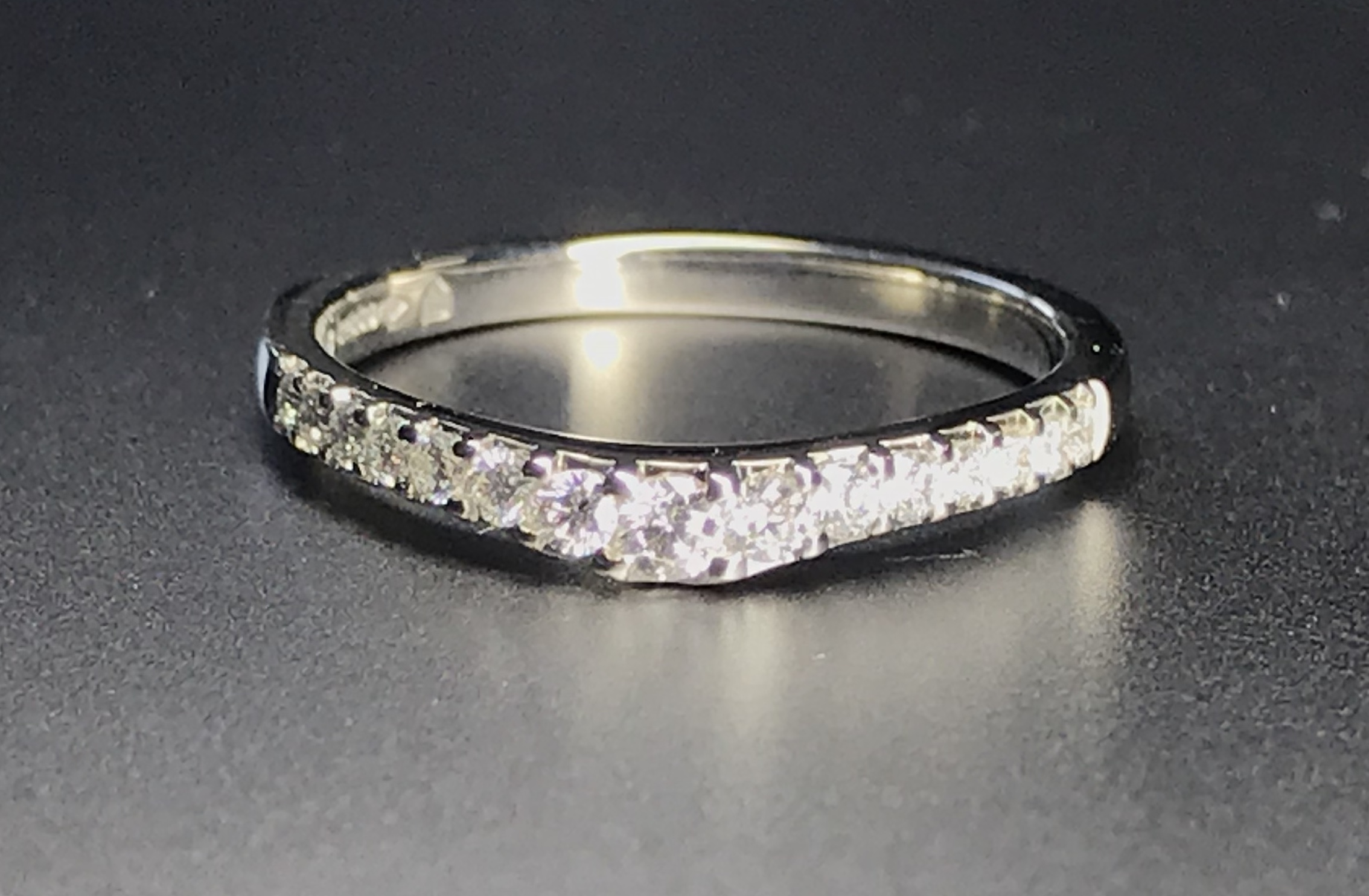 Copy of Platinum graduated and shaped cut away set diamond wedding ring