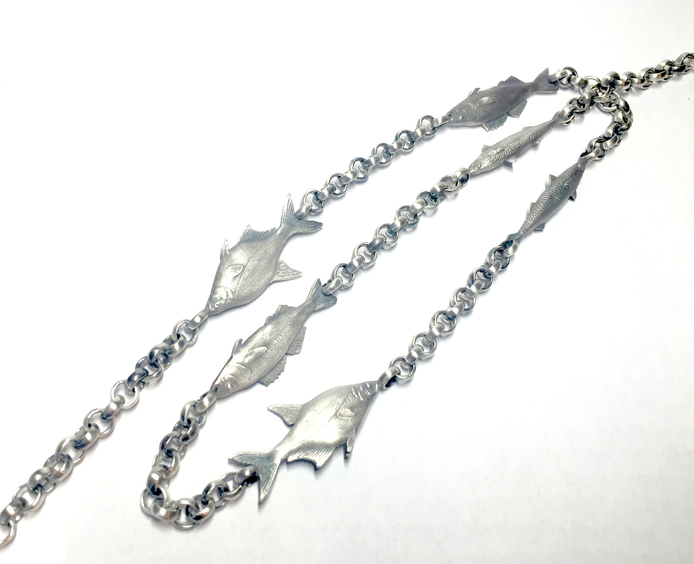 Sterling silver fish necklace. Bespoke work for a local fisherman. Made in Chichester, England.