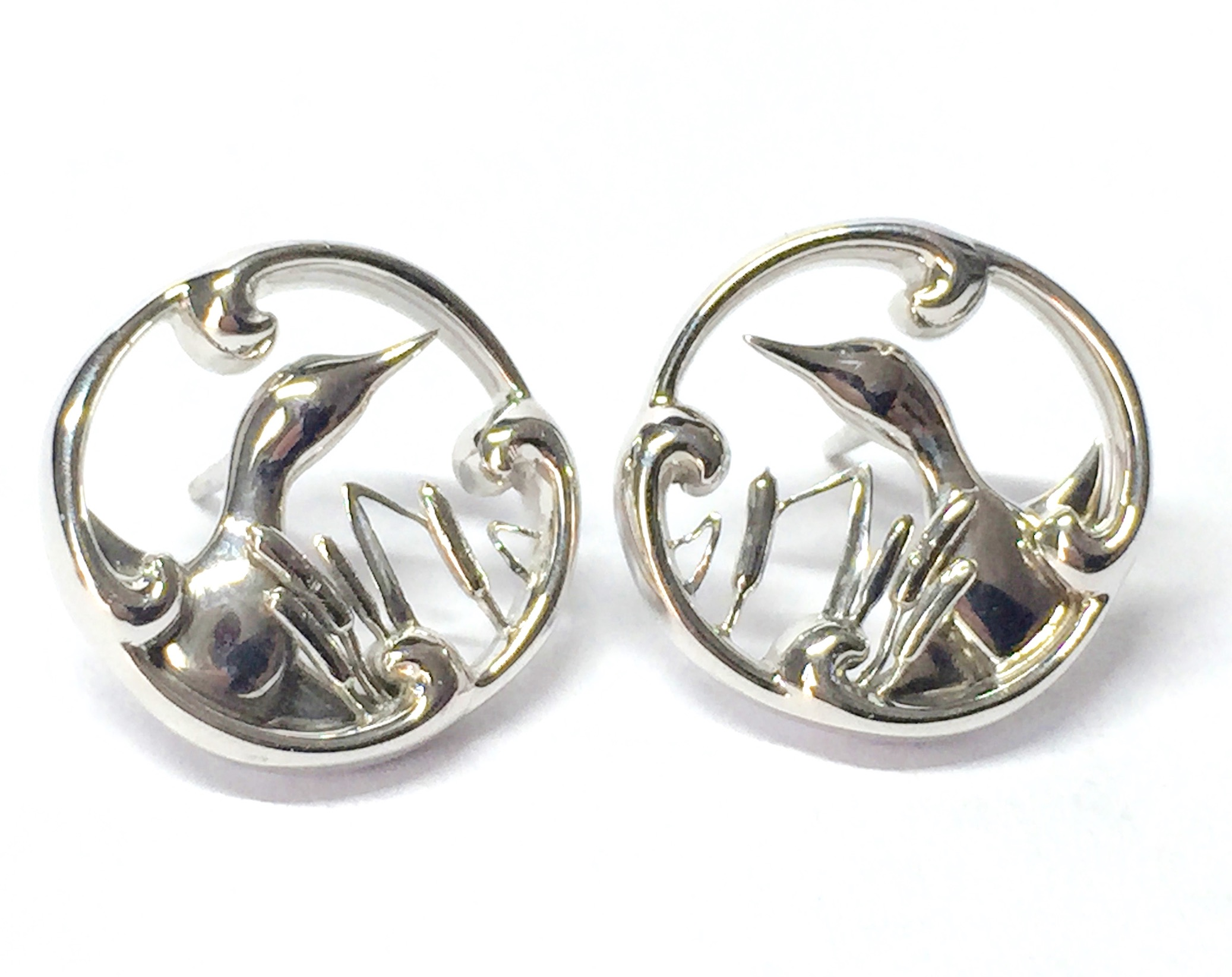 Bespoke white gold duck earrings. Made in Chichester, England.