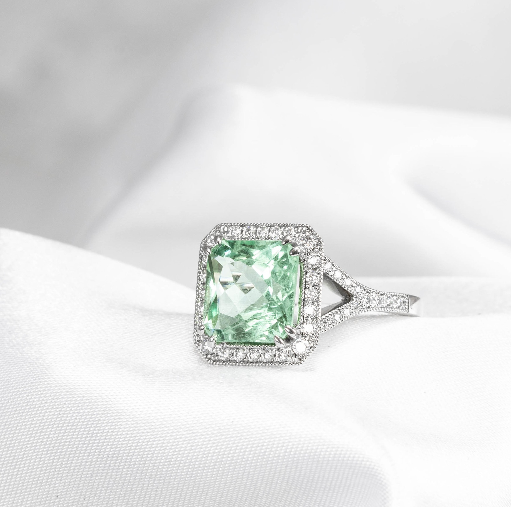 Mint aquamarine and diamond octagonal cluster ring. Made in Chichester, England.