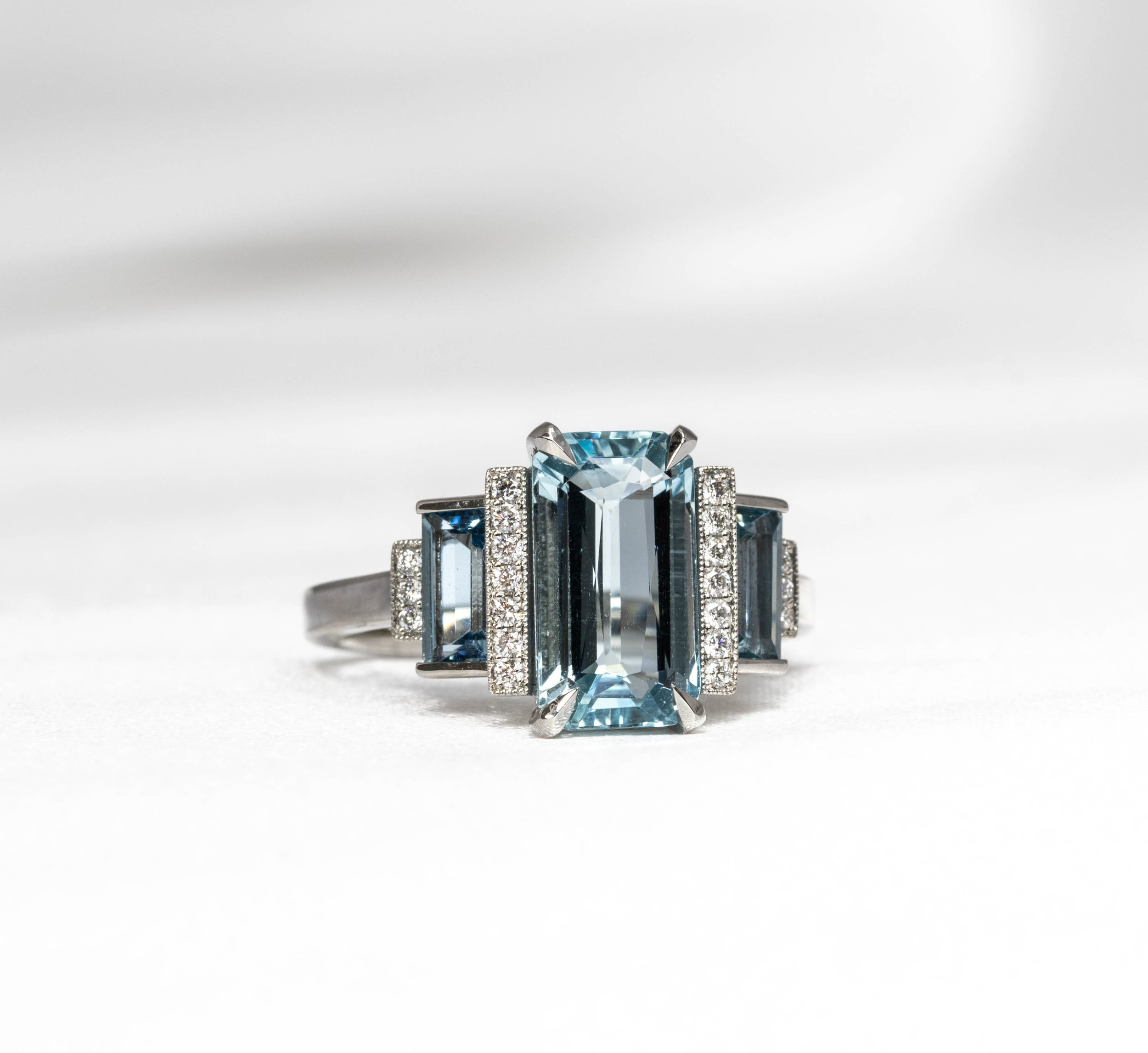Aquamarine and grain set diamond Art Deco style stepped ring. Made in Chichester, England.