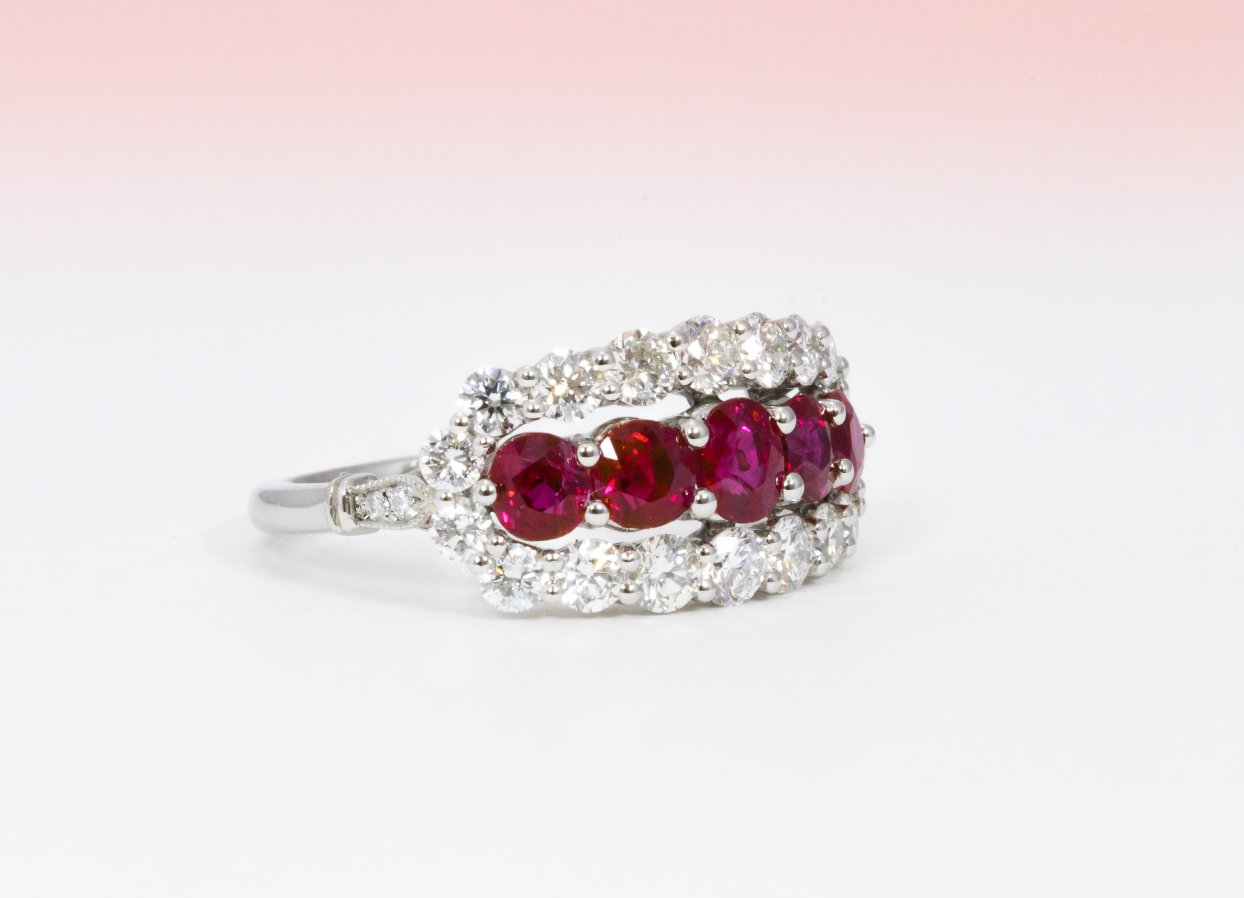 Platinum mounted Burmese ruby and diamond half hoop ring. Made in Chichester, England.