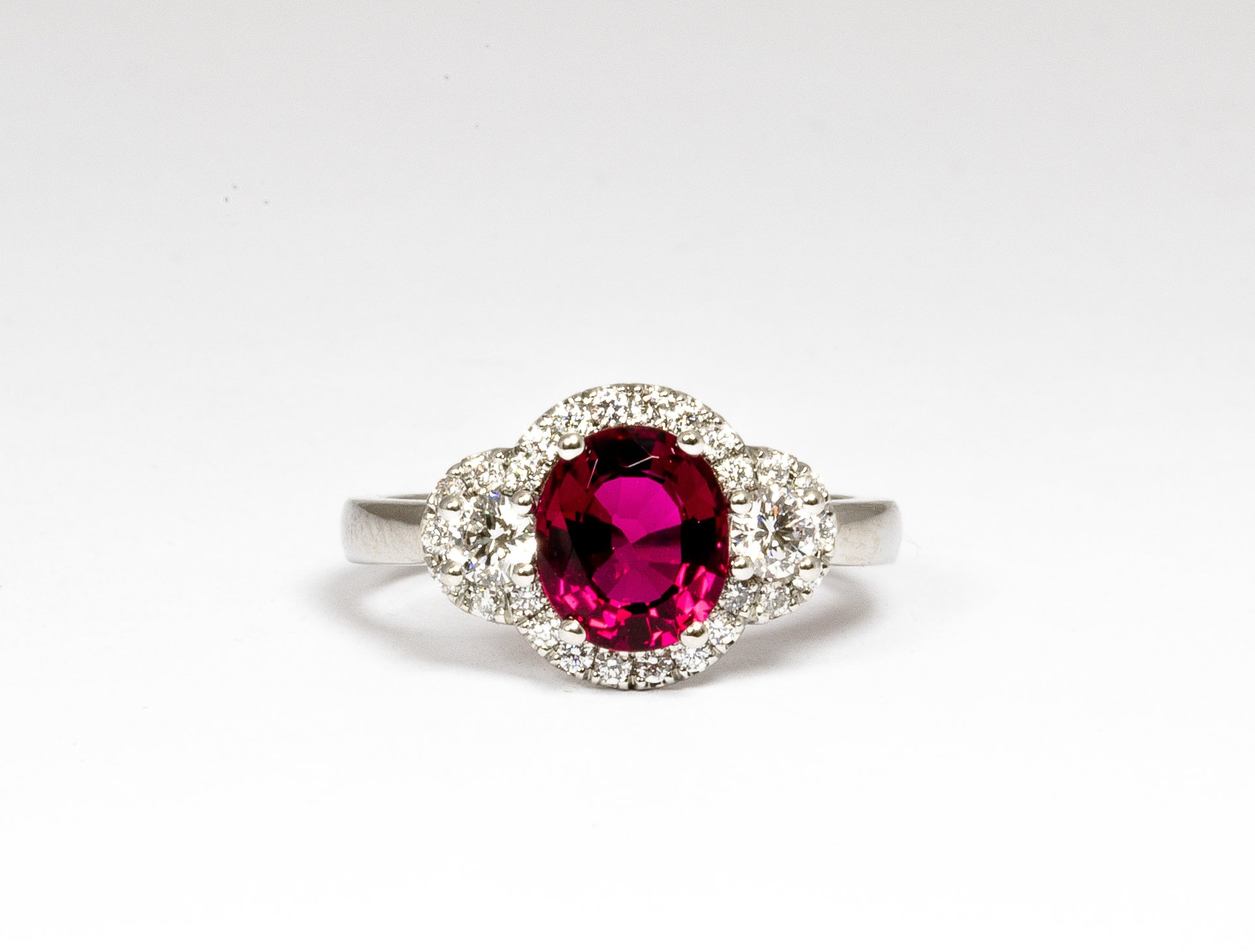 Platinum mounted diamond and rubellite set cluster ring. Made in Chichester, England.