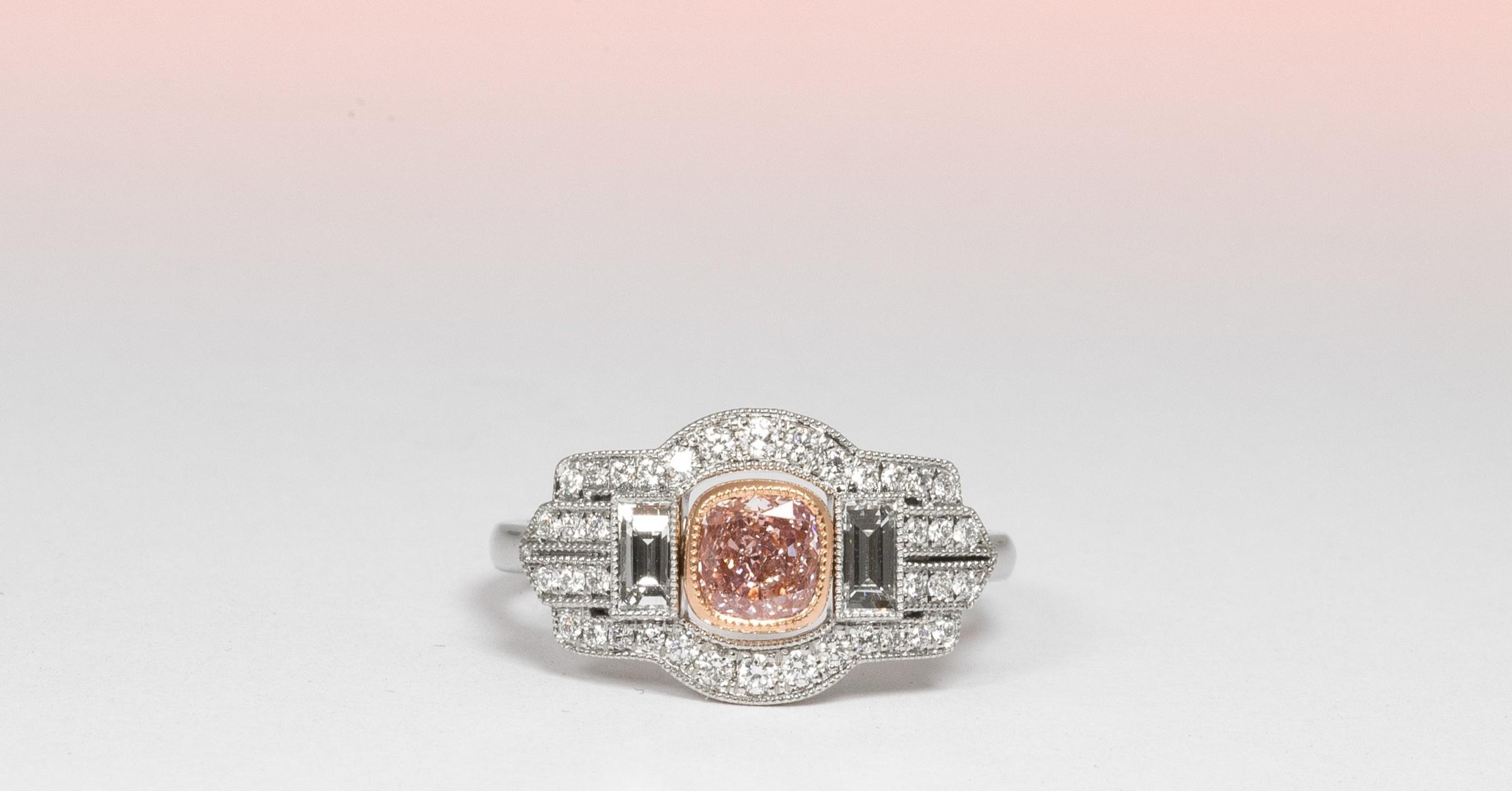 Natural pink diamond set in rose gold with platinum white diamond set mount.