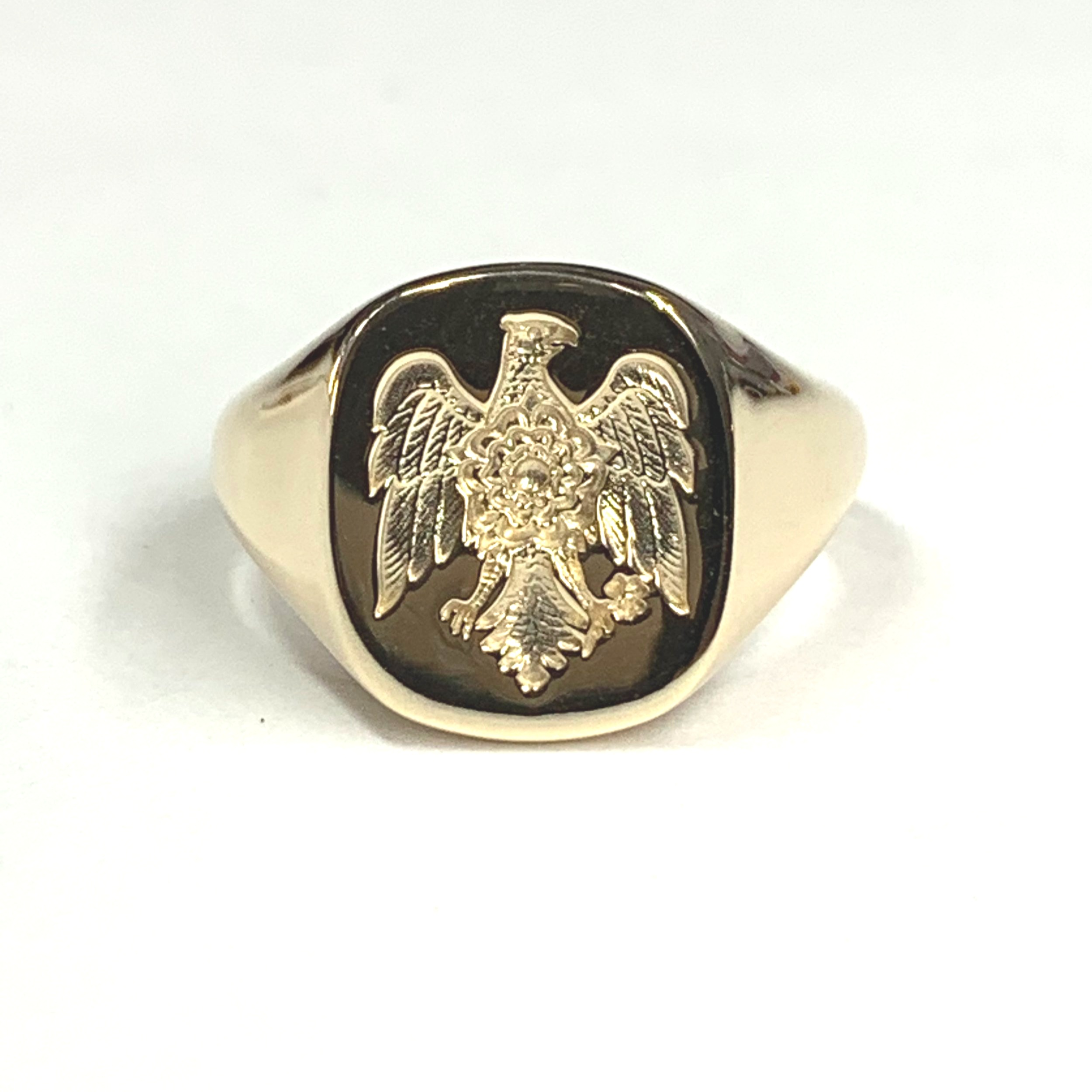 9ct yellow gold oblong cushion shaped signet ring with seal engraved family crest.