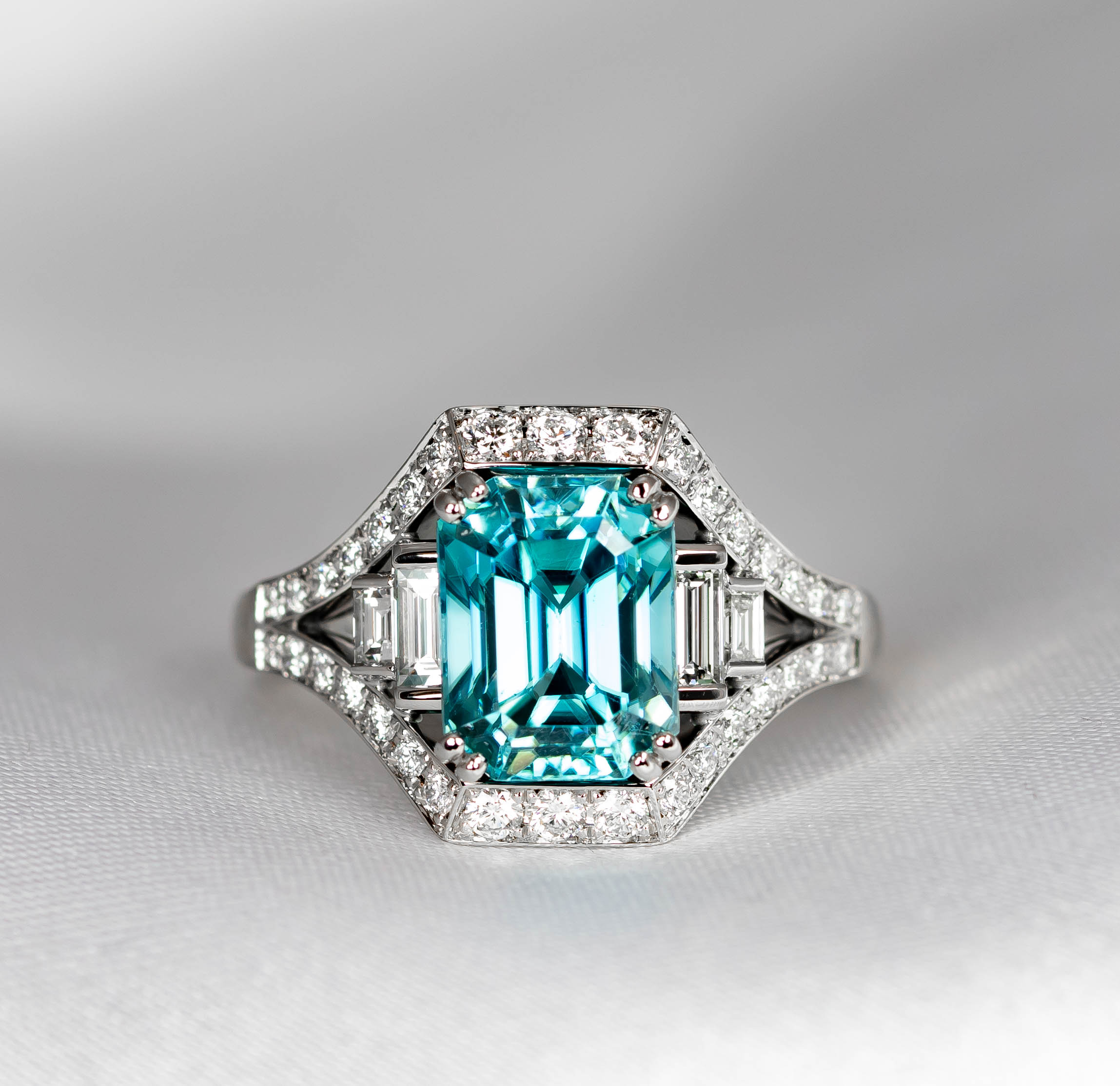 Bespoke Zircon and diamond platinum ring made with customers 5.02ct blue zircon. Made in Chichester, England.