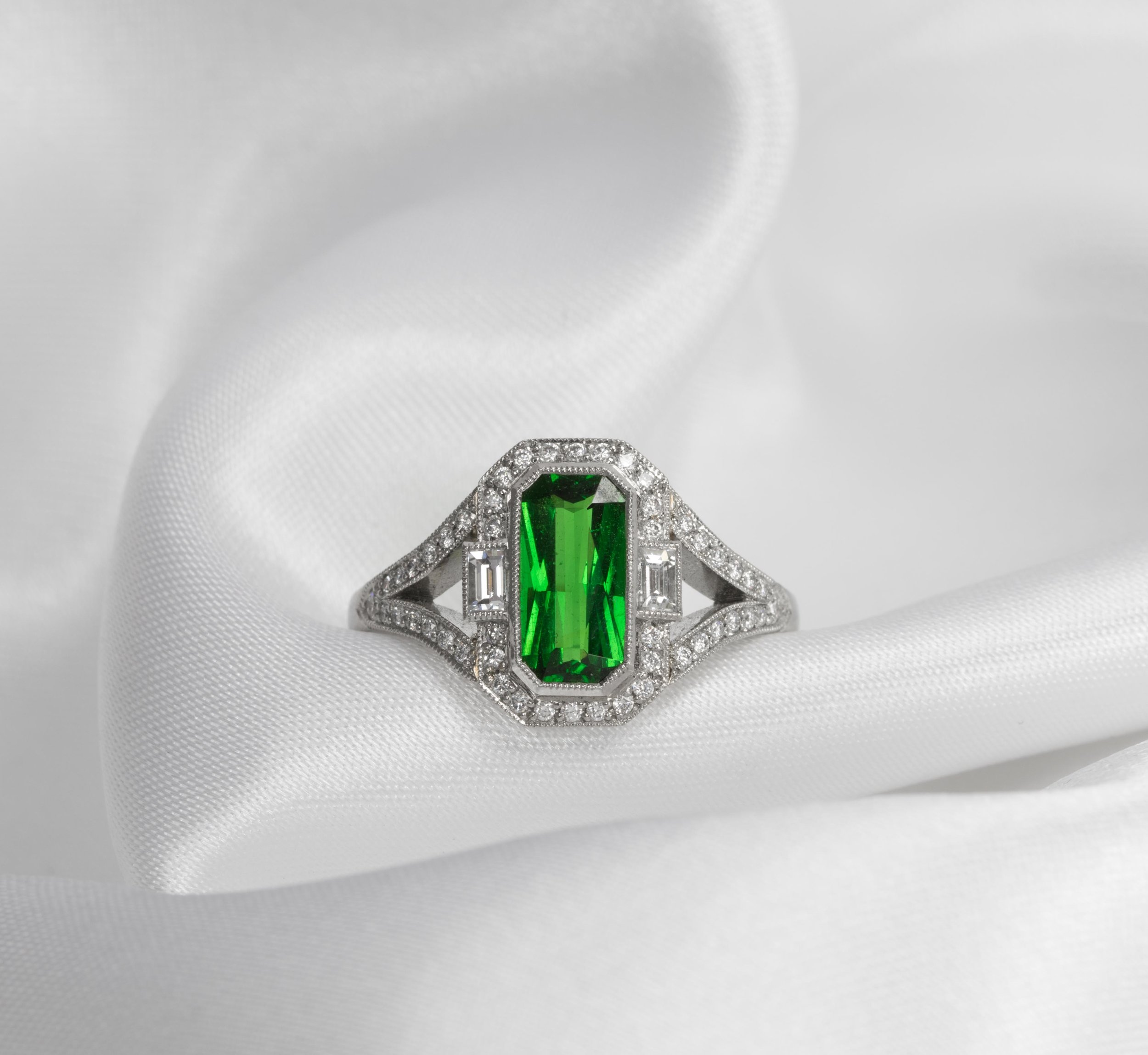 18ct white gold mounted Tsavorite garnet and diamond Art Deco style cluster ring. Made in Chichester, England.