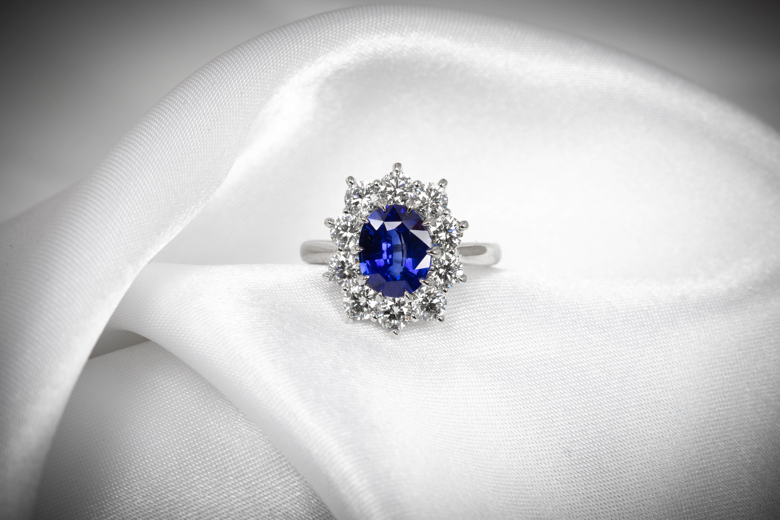 Platinum mounted 2.53ct Sri Lankkan sapphire in low profile basket claw setting. Made in Chichester, England.