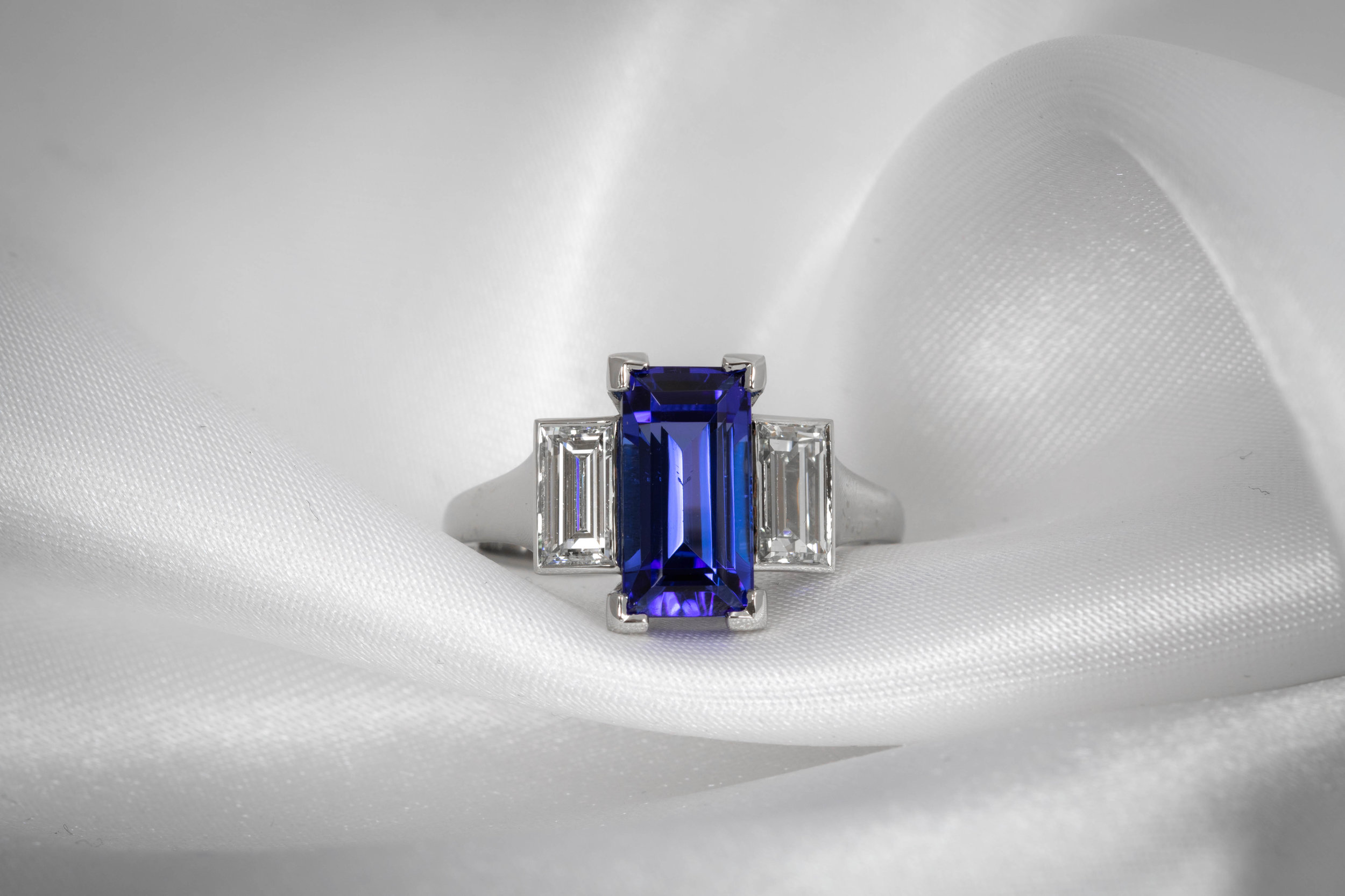Platinum mounted 1.22ct total baguette diamond and 3.64ct baguette tanzanite (customers stone) 3 stone ring. Made in Chichester, England.