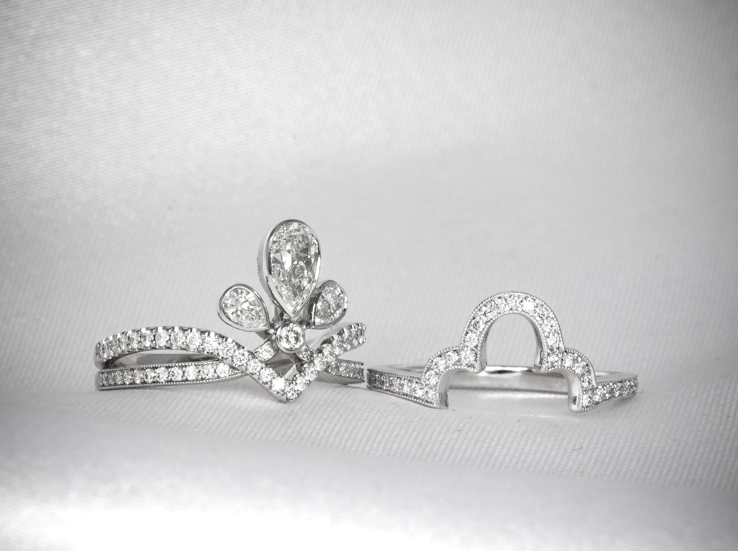 The platinum tiara ring with the bespoke fitted diamond shaped platinum and diamond band. Made in Chichester, England.