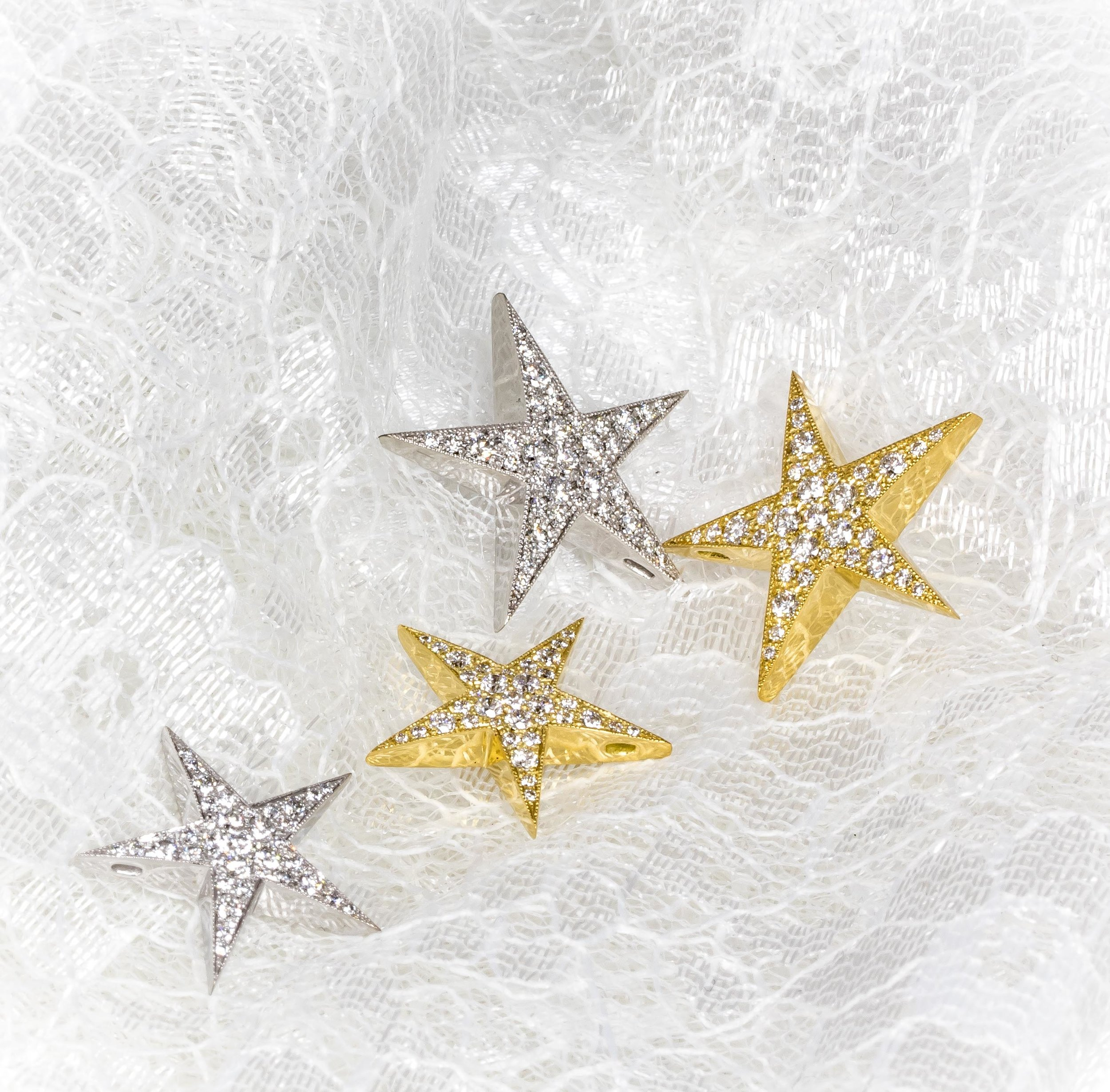 18ct yellow and white gold diamond set star pendants. Made in Chichester, England.