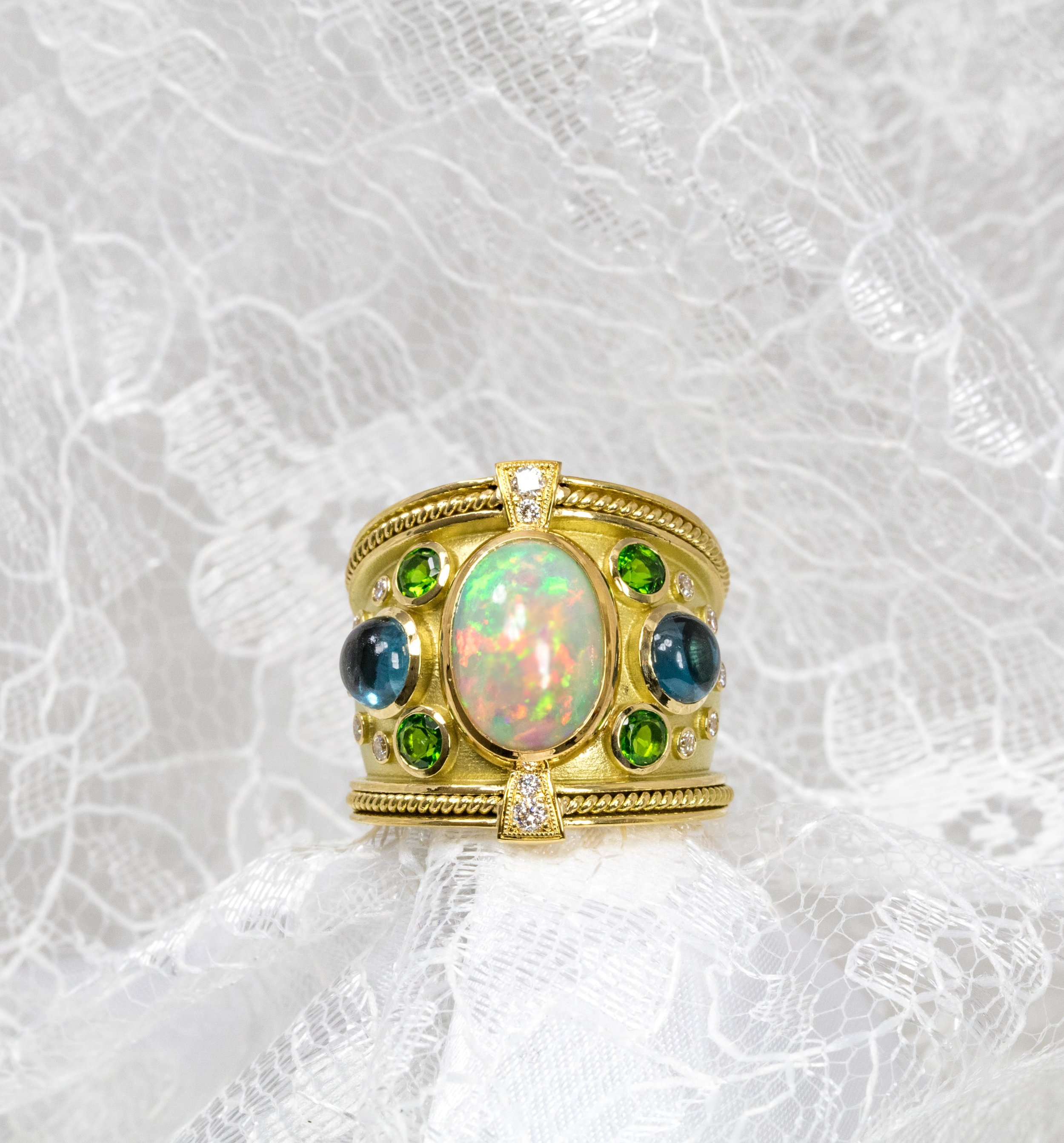 18ct opal, diamond,blue London topaz and green diopside wide band ring. Made in Chichester, England.