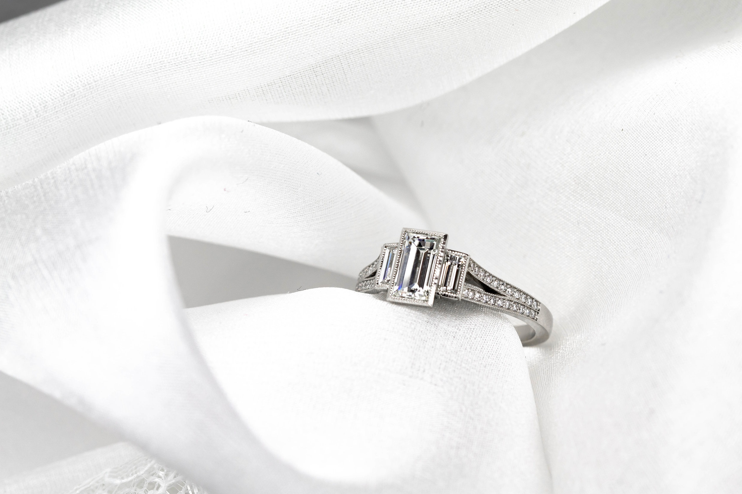 Platinum mounted 3 stone baguette diamond ring. Made in Chichester, England.