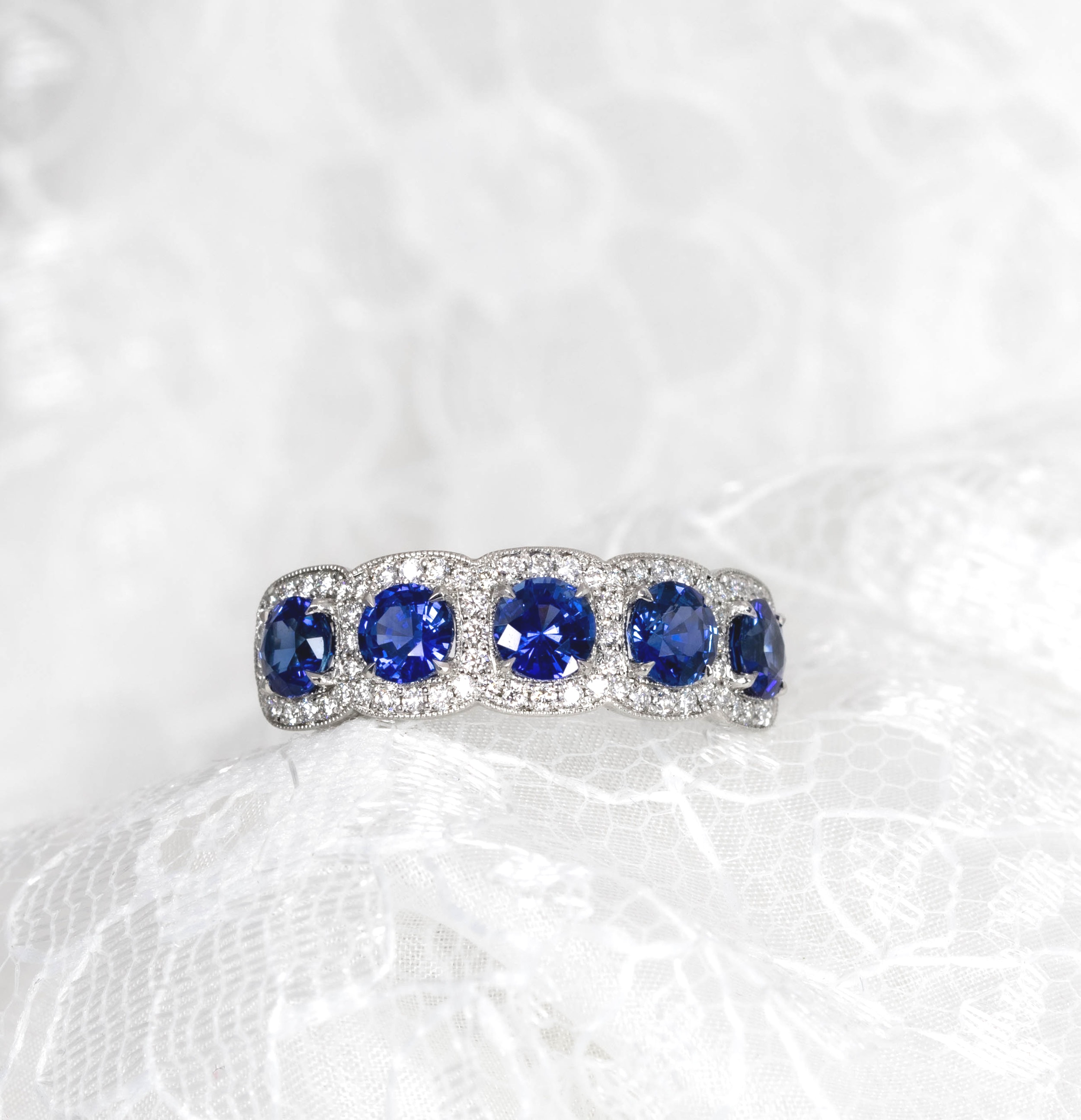 Platinum mounted sapphire and diamond 5 cluster half hoop ring. Made in Chichester, England.
