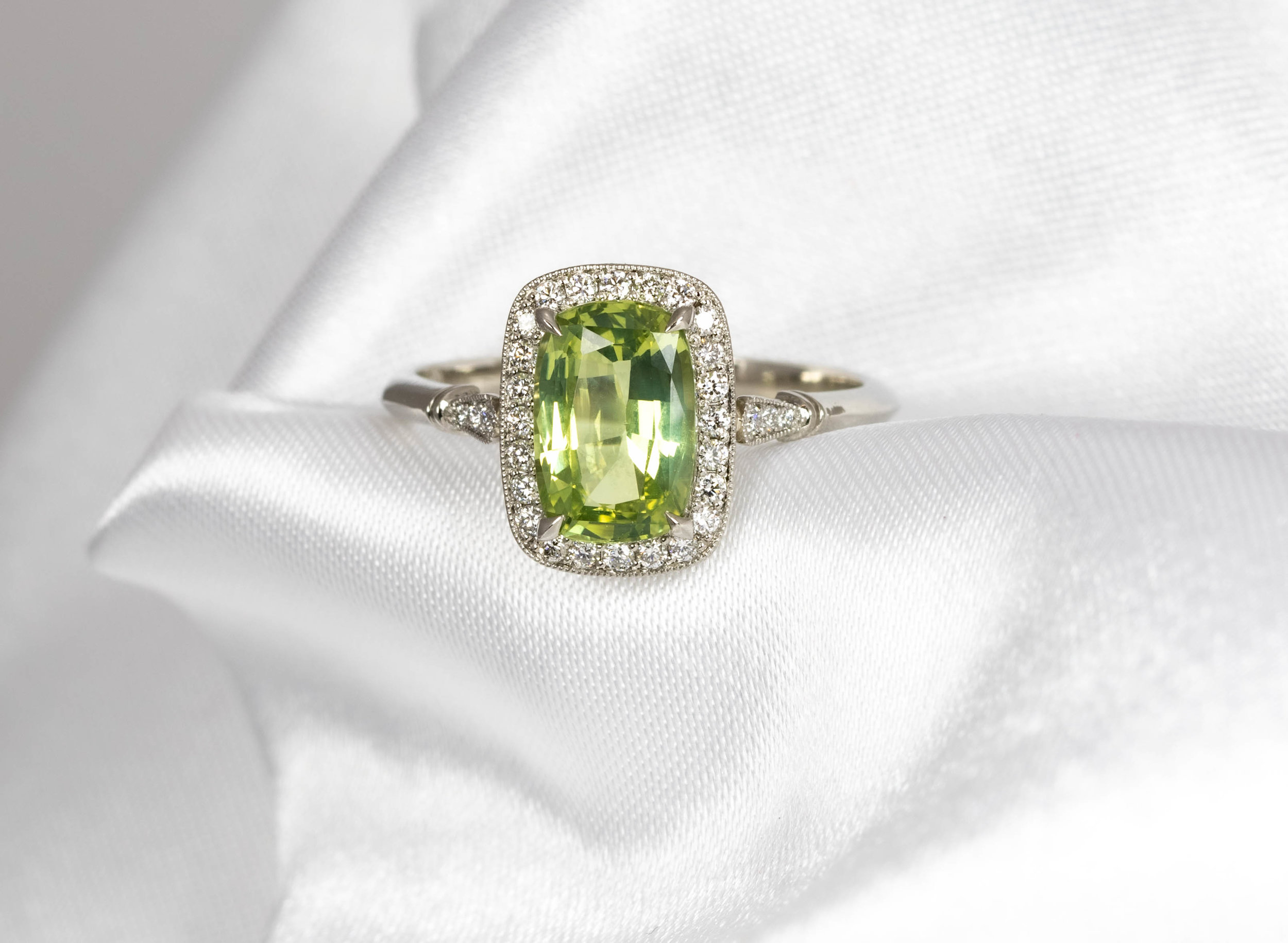 Platinum mounted 1.88ct oblong cushion cut Chrysoberyl and diamond cluster ring. Made in Chichester, England.