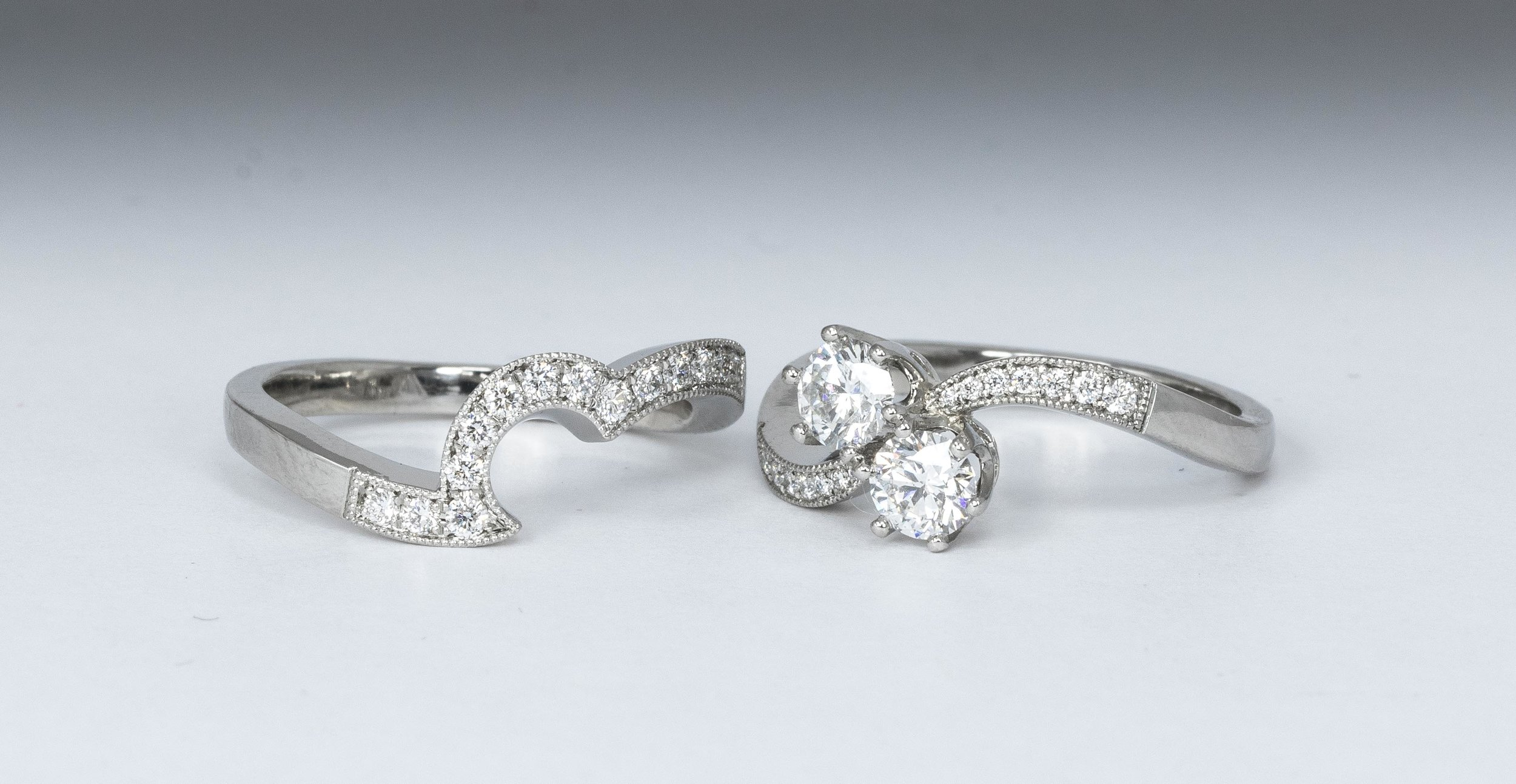 A Diamond set shaped or contour fit band, made to fit with a two stone diamond twist ring. Both from the workshops of Timothy Roe, Chichester, England.