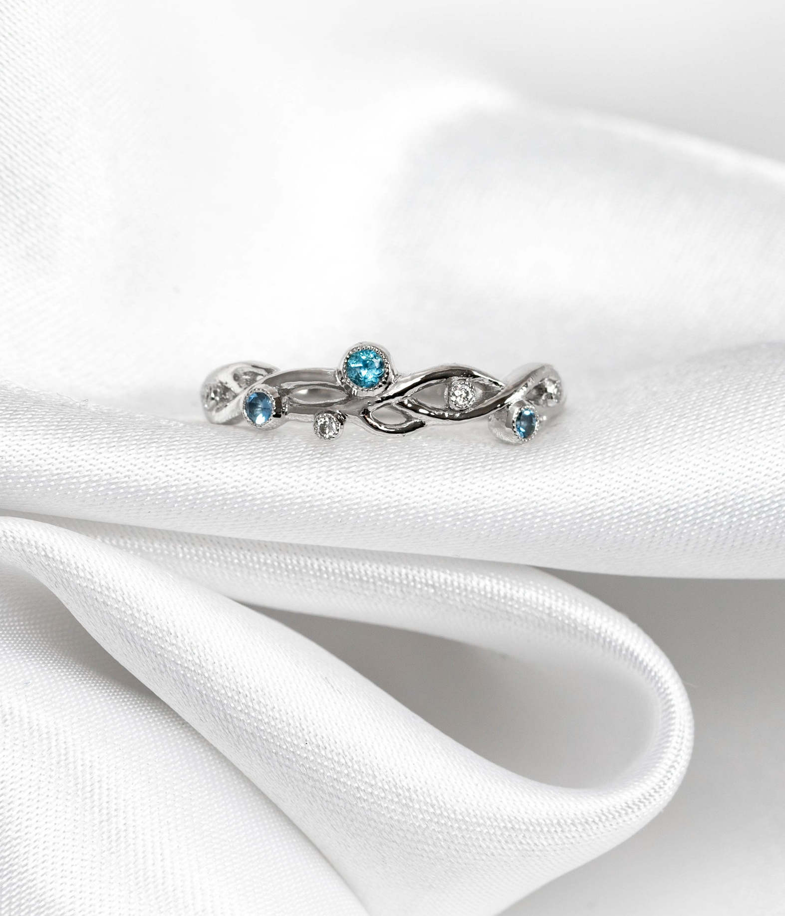 Platinum mounted Aquamarine and diamond entwined band ring. Made in Chichester, England.