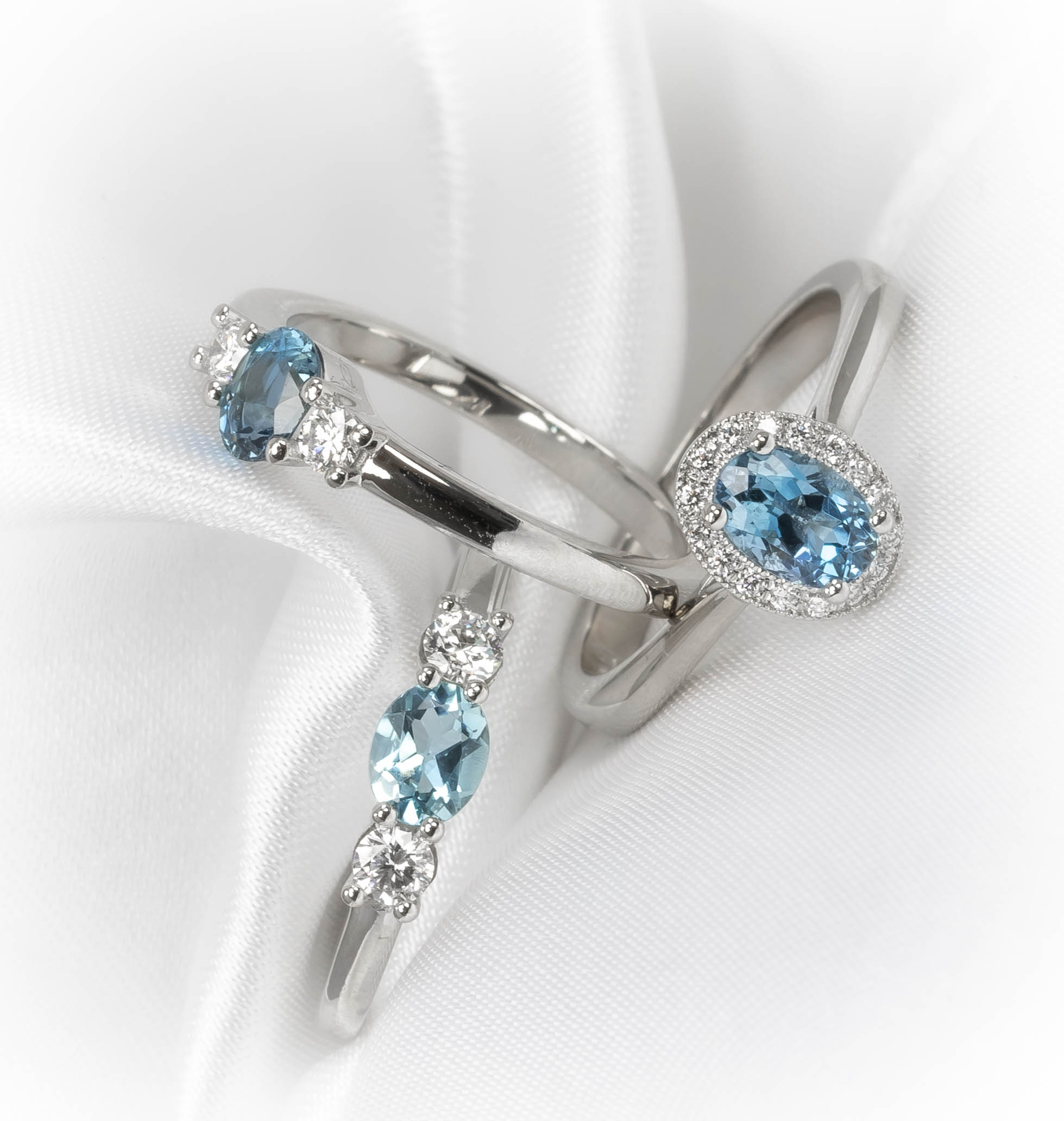 Platinum mounted aquamarine and diamond set rings. Made in Chichester, England.