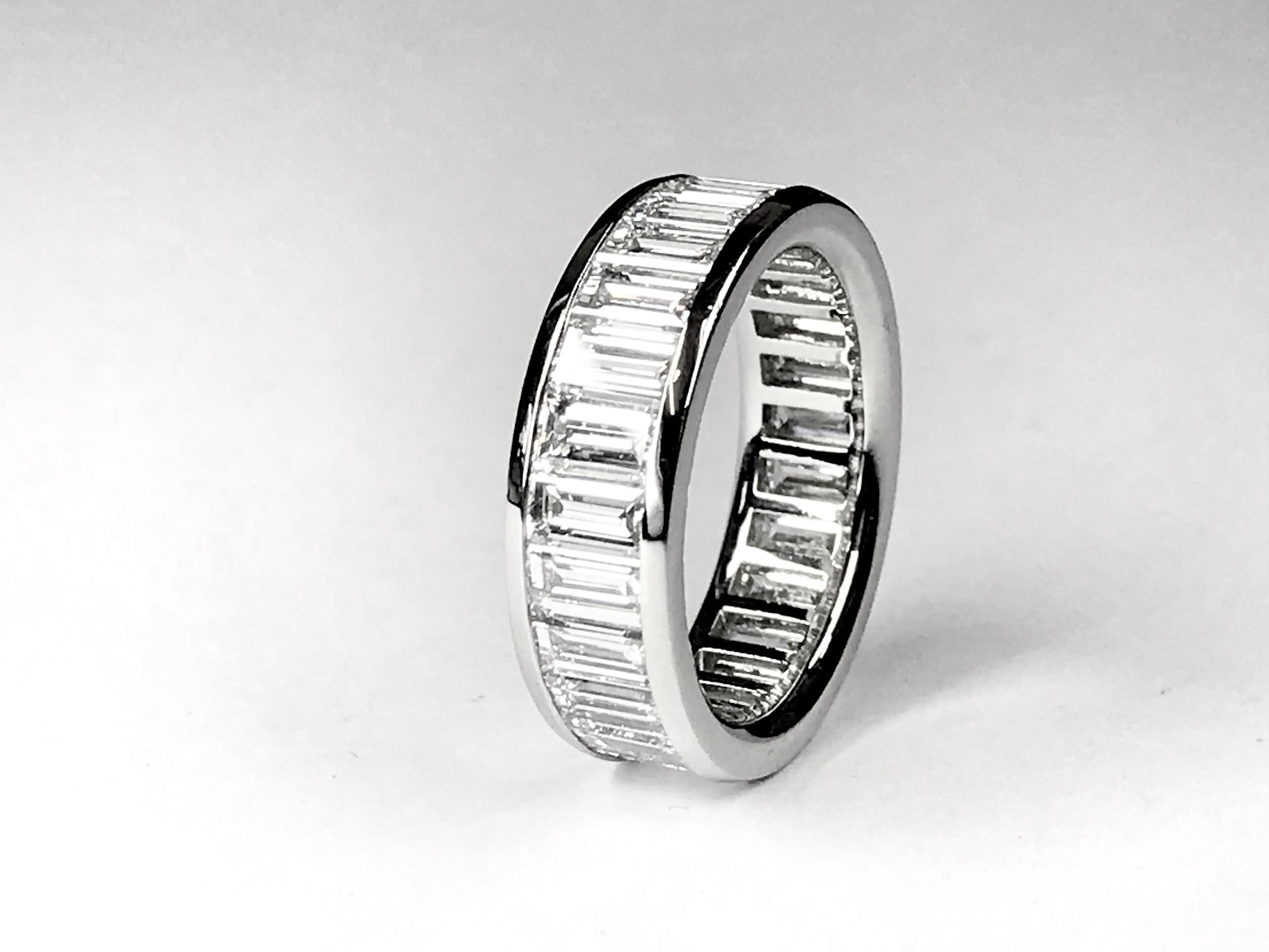 Platinum mounted 5ct total baguette cut diamond eternity ring. Made in Chichester, England.